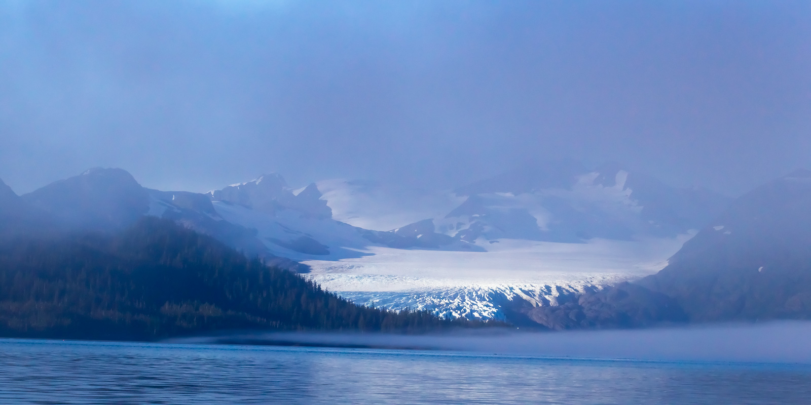 A Limited Edition, Fine Art photograph of an impressive glacier in the morning fog on Prince William Sound in Alaska.  Available...