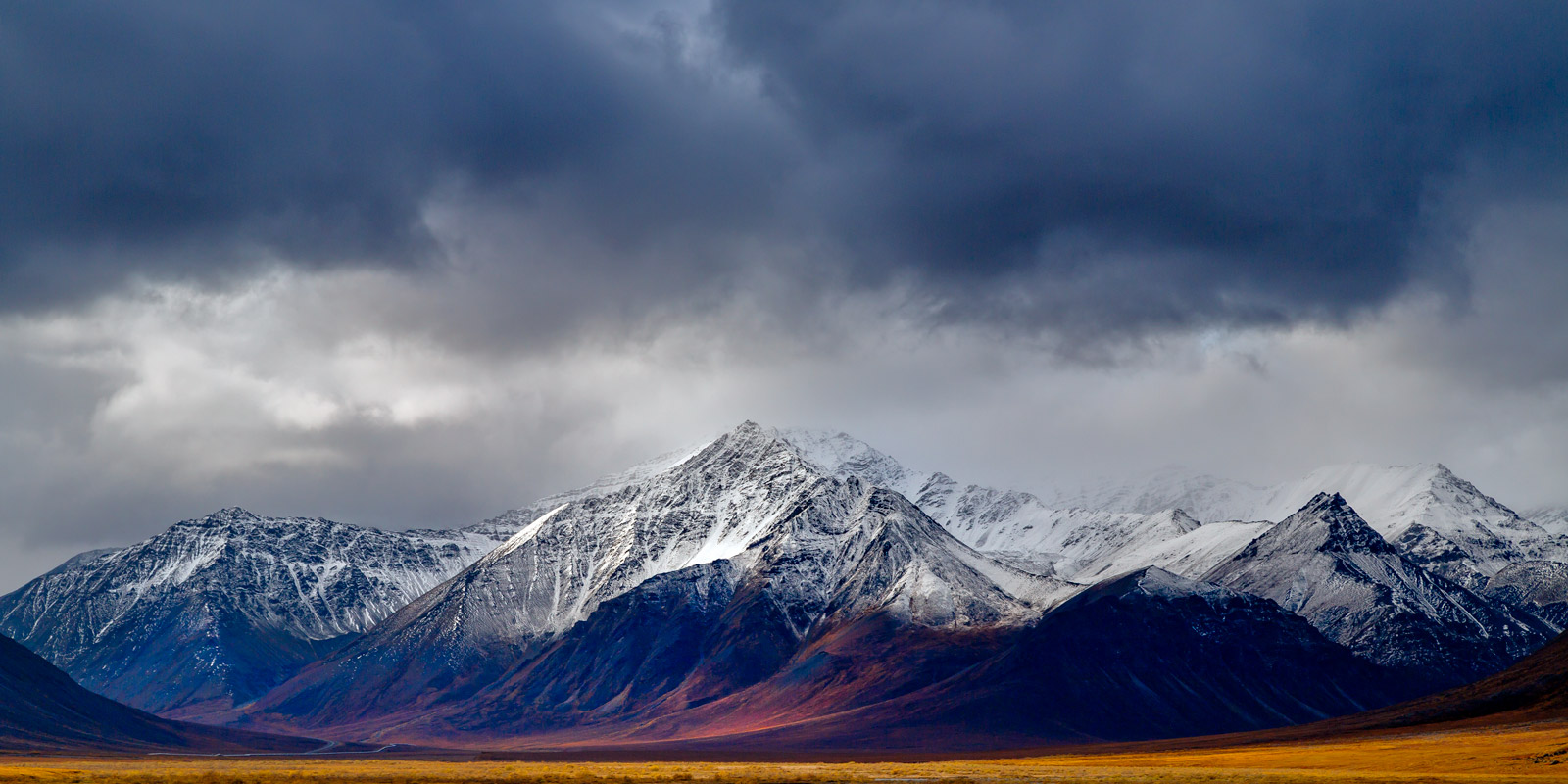 A Limited Edition, Fine Art photograph of mountains in the Brooks Range of Alaska with a dramatic scene of storm clouds over...