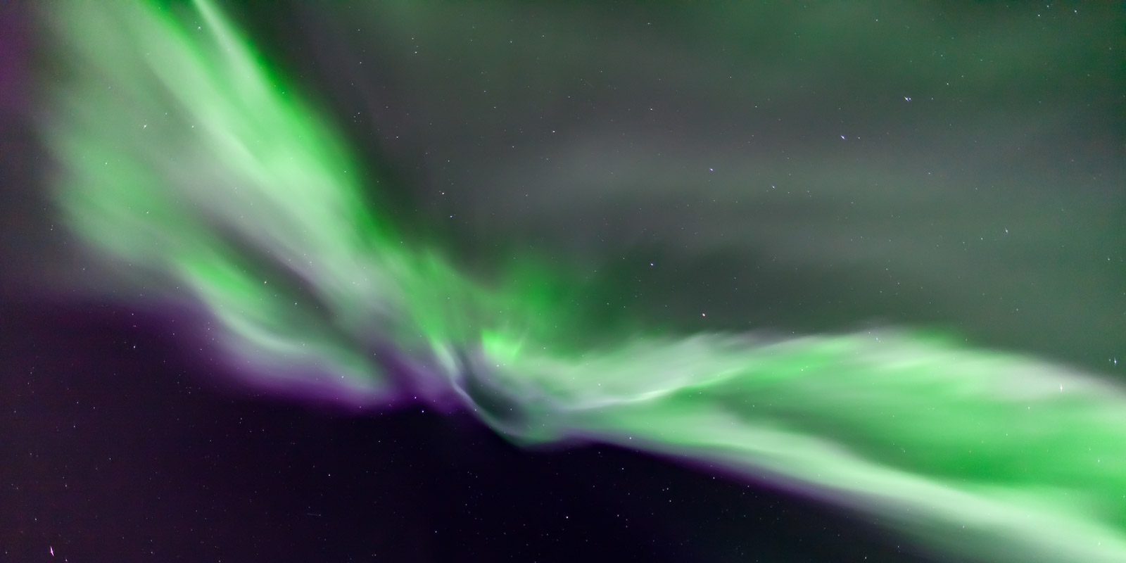 A Limited Edition, Fine Art photograph of a brilliant wing shaped aurora in the skies overhead in Fairbanks, Alaska.  This Northern...