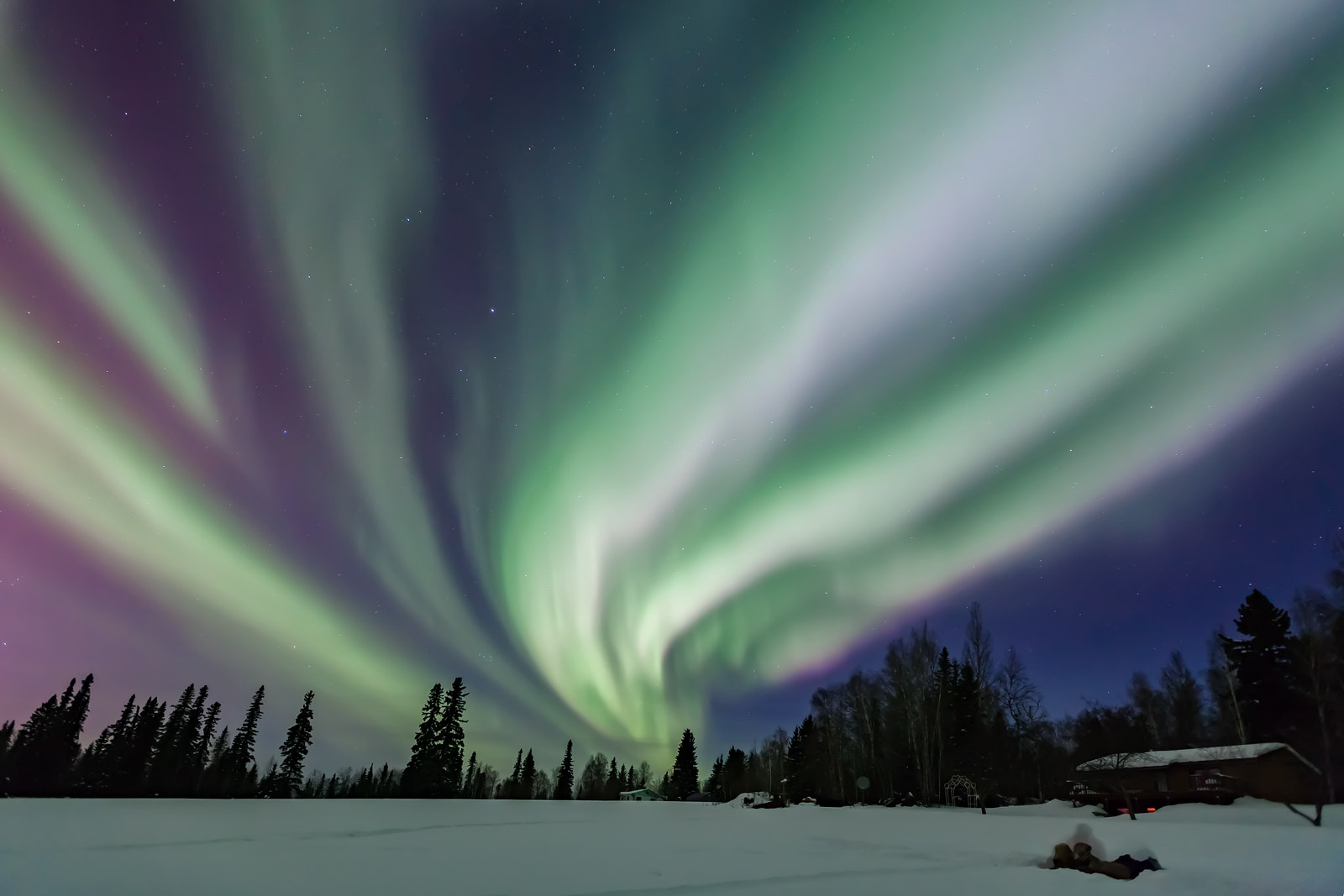 A Limited Edition, Fine Art photograph of a gigantic aurora providing a bright night light over a snow covered field and cabin...