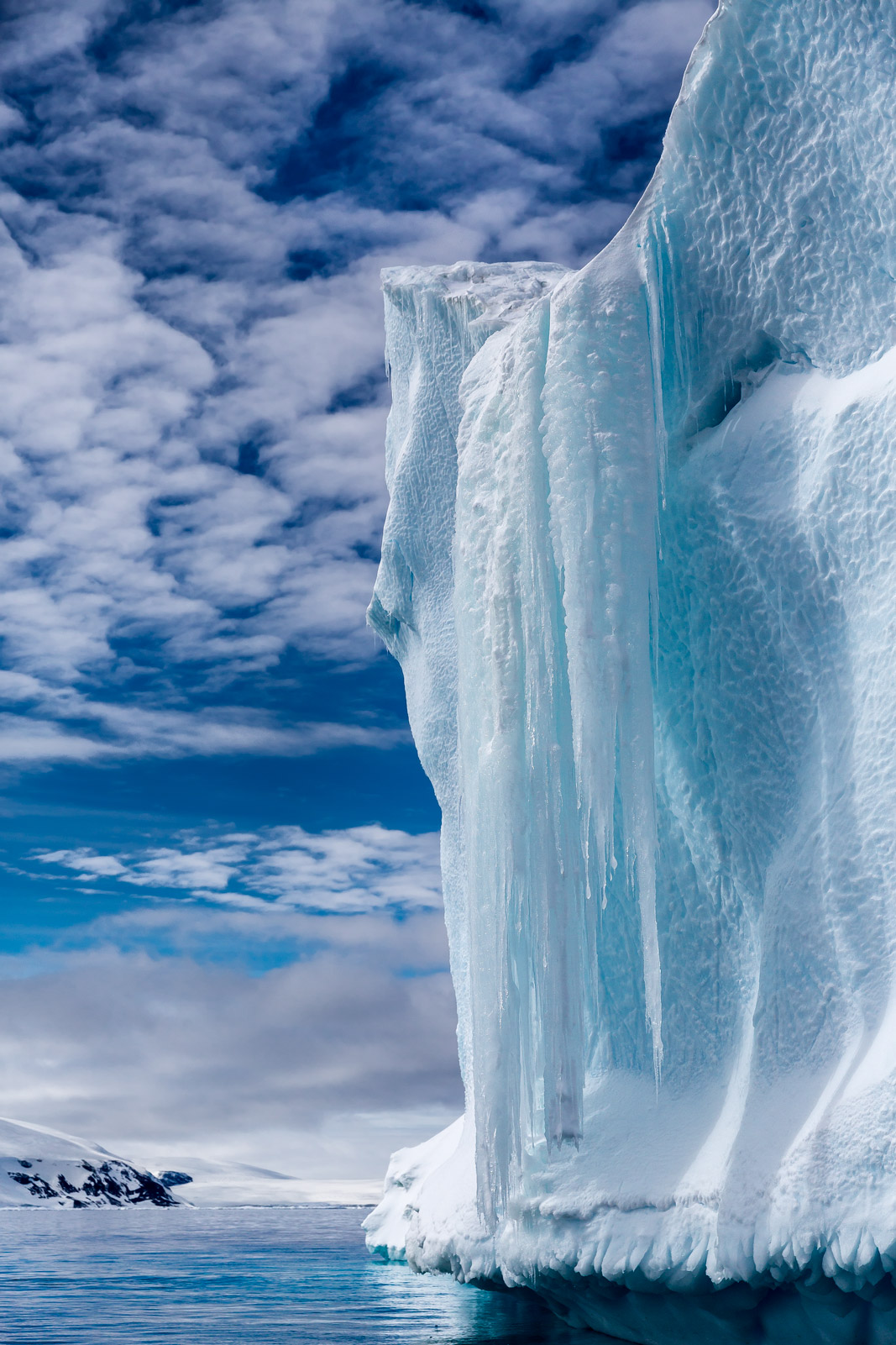 A Limited Edition, Fine Art photograph in Antarctica of a stunningly beautiful frozen waterfall that is the result of an iceberg...