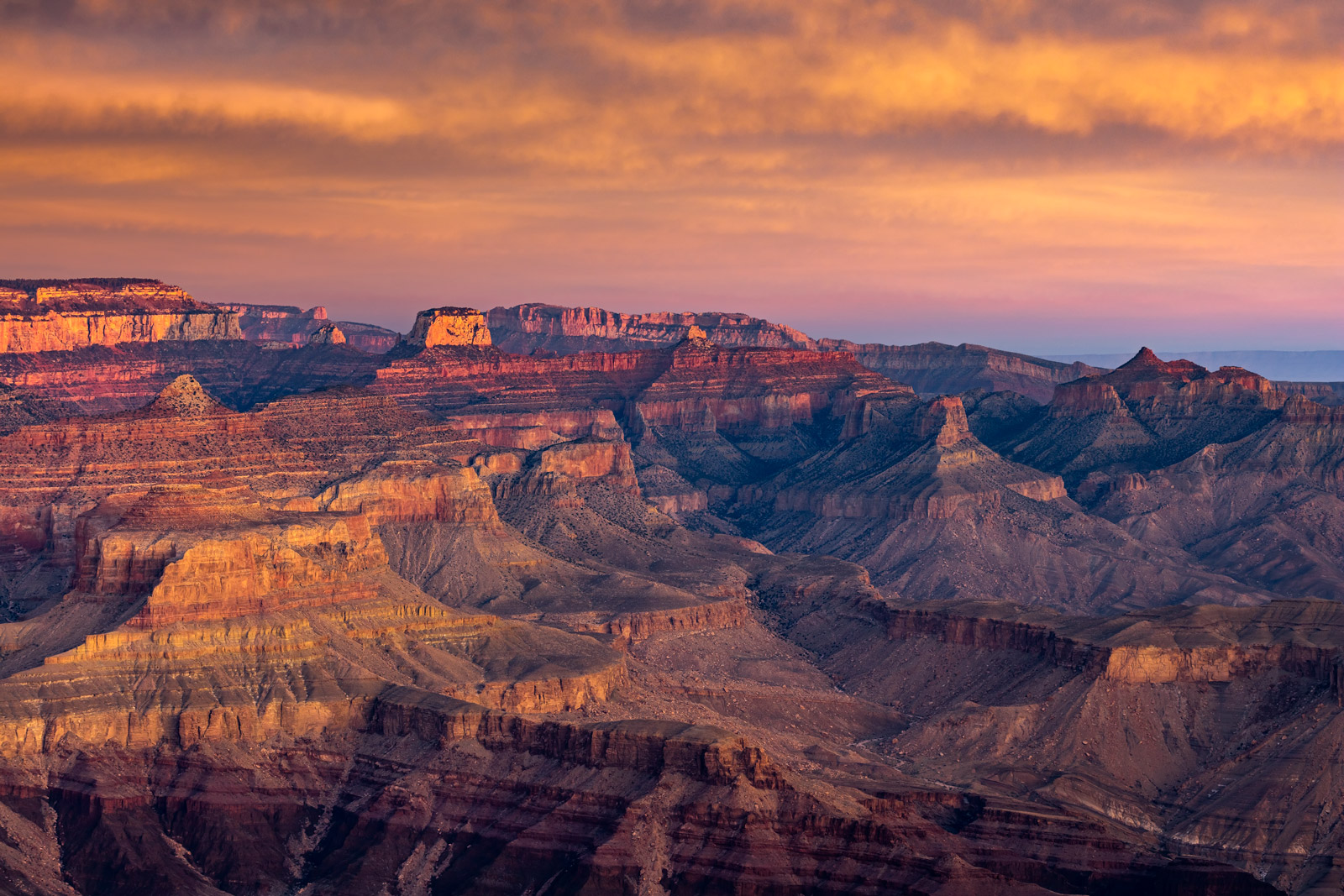 A Limited Edition, Fine Art photograph of a dramatic sunrise lighting up the walls of the canyons in the Grand Canyon National...