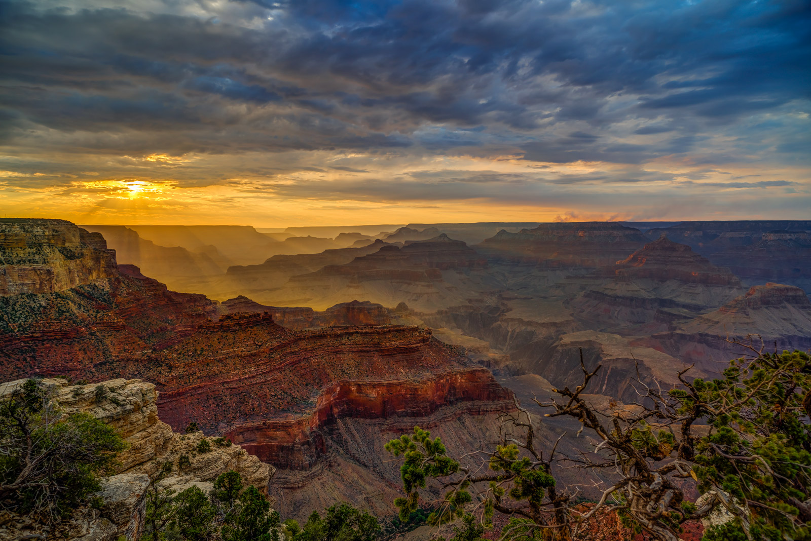 A Limited Edition, Fine Art photograph of a dramatic sunset that was undeterred by the storm clouds in the Grand Canyon National...
