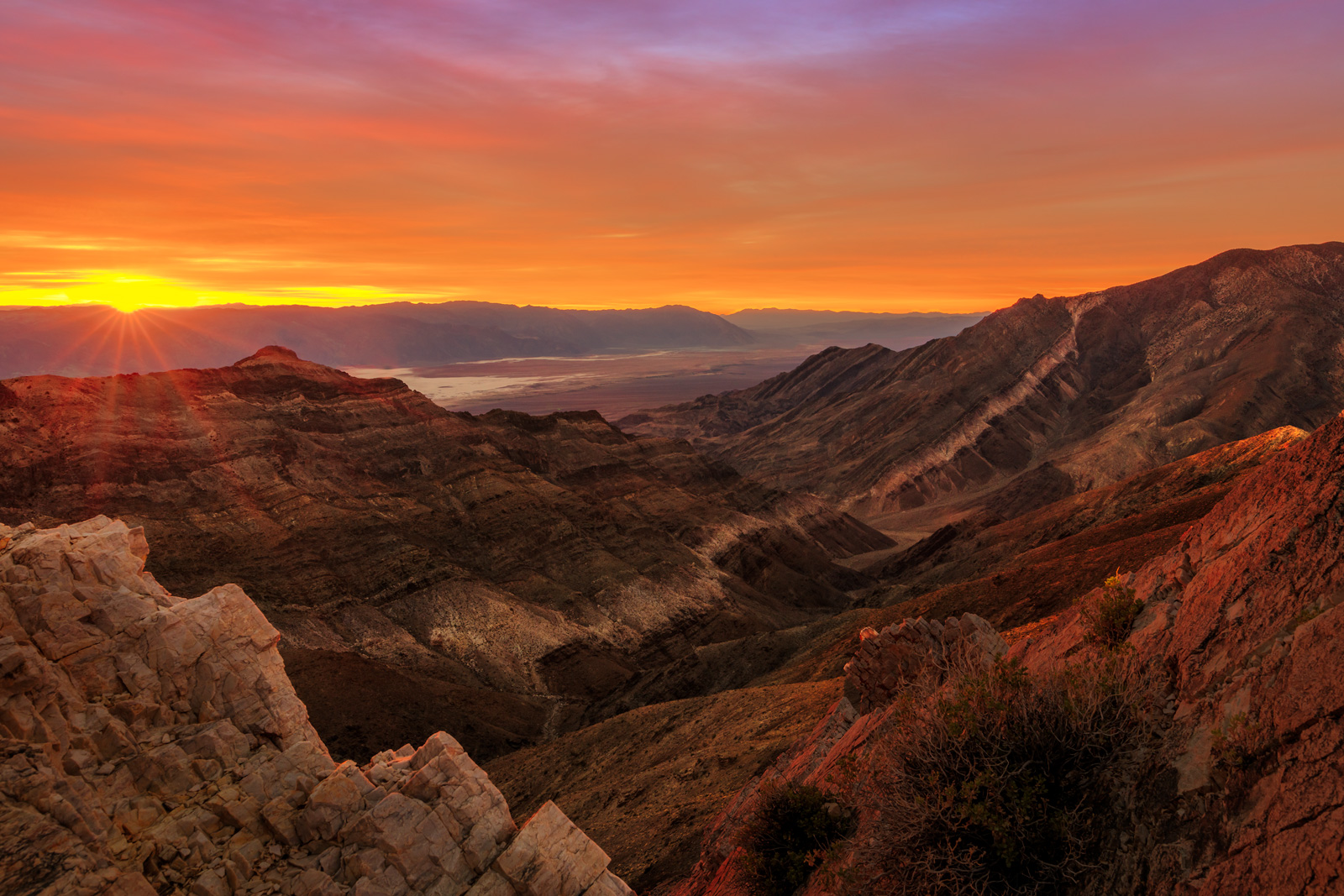 A Limited Edition, Fine Art photograph of a stunning sunburst and sunrise over the valley from Aguereberry Point in Death Valley...
