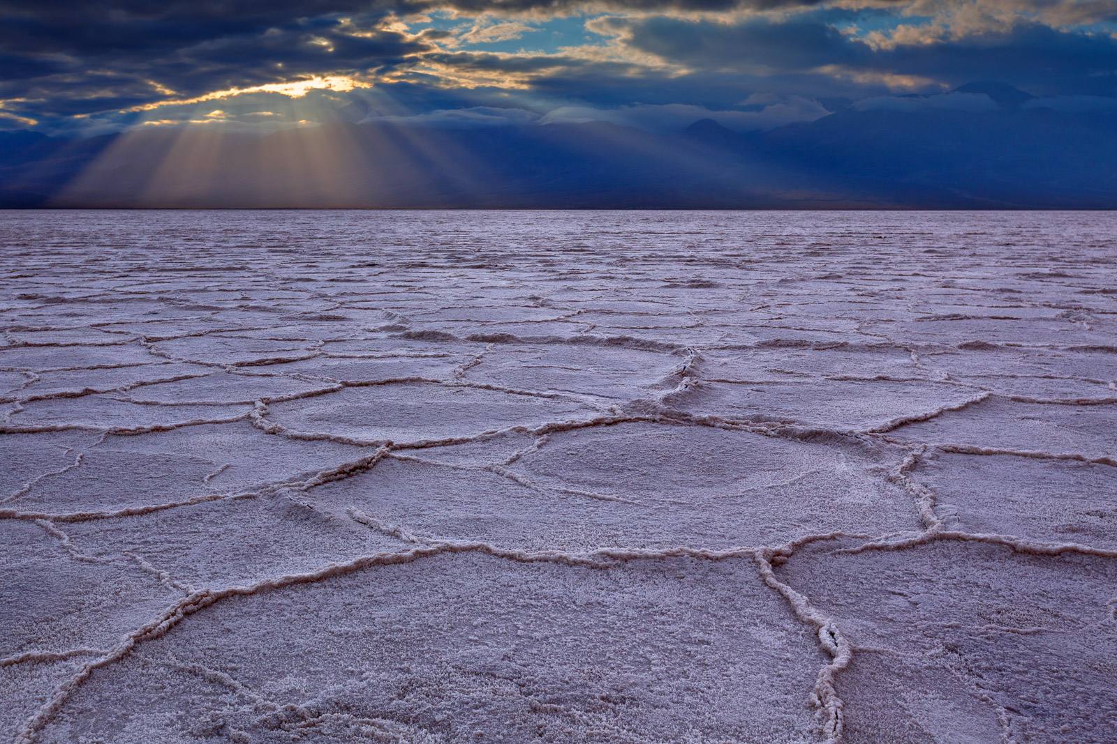A Limited Edition, Fine Art photograph of Badwater Basin with dramatic sunbeams over the geometric patters in the floor of the...