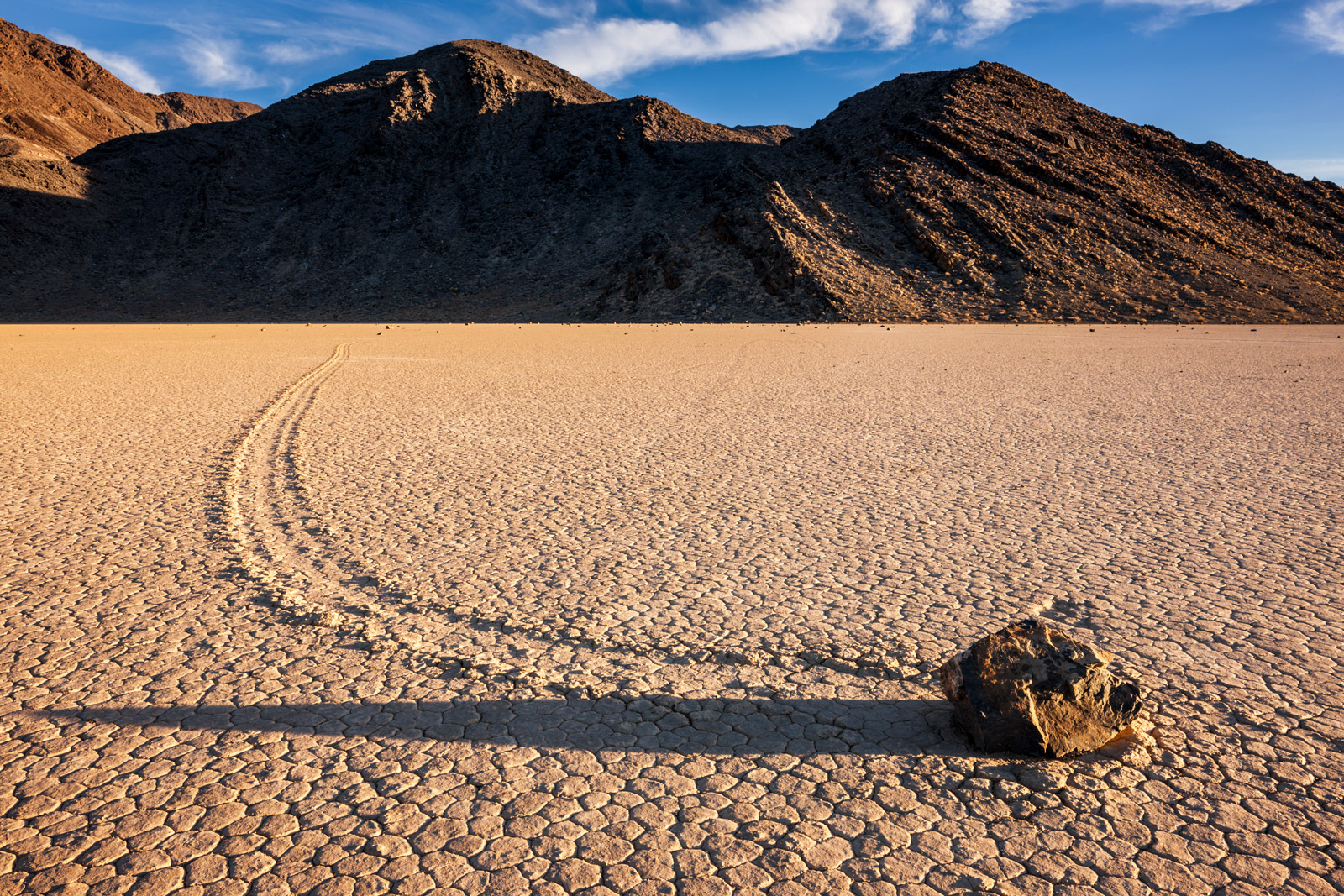 """A Limited Edition photograph of one of the famous """"moving rocks"""" and it's long shadow at The Racetrack in Death Valley National..."""
