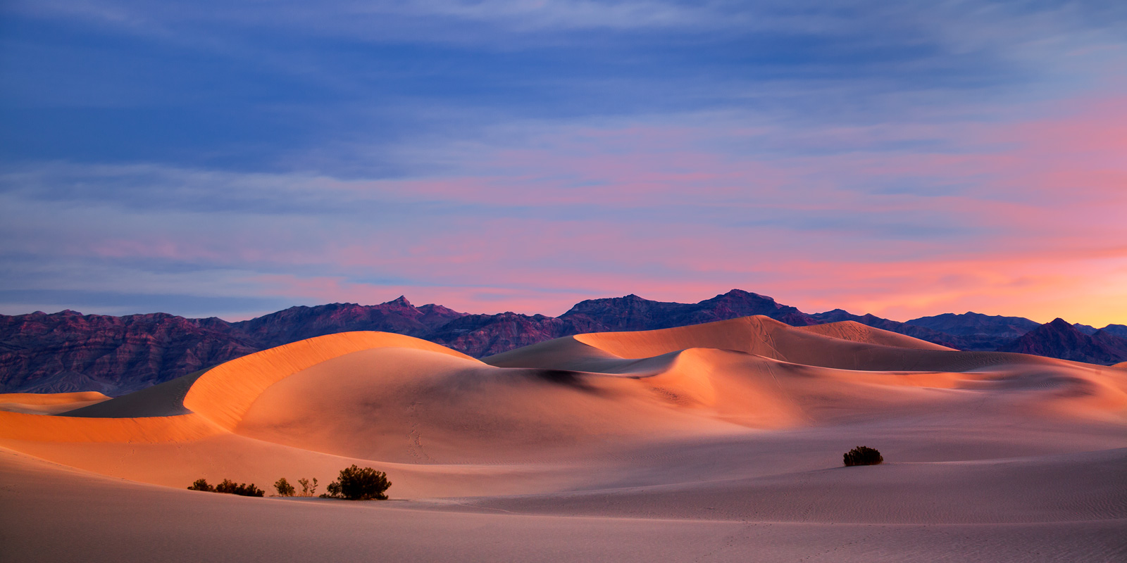 A Limited Edition, Fine Art photograph of Mesquite Dunes with beautiful warm light on the sand dunes at sunrise in Death Valley...