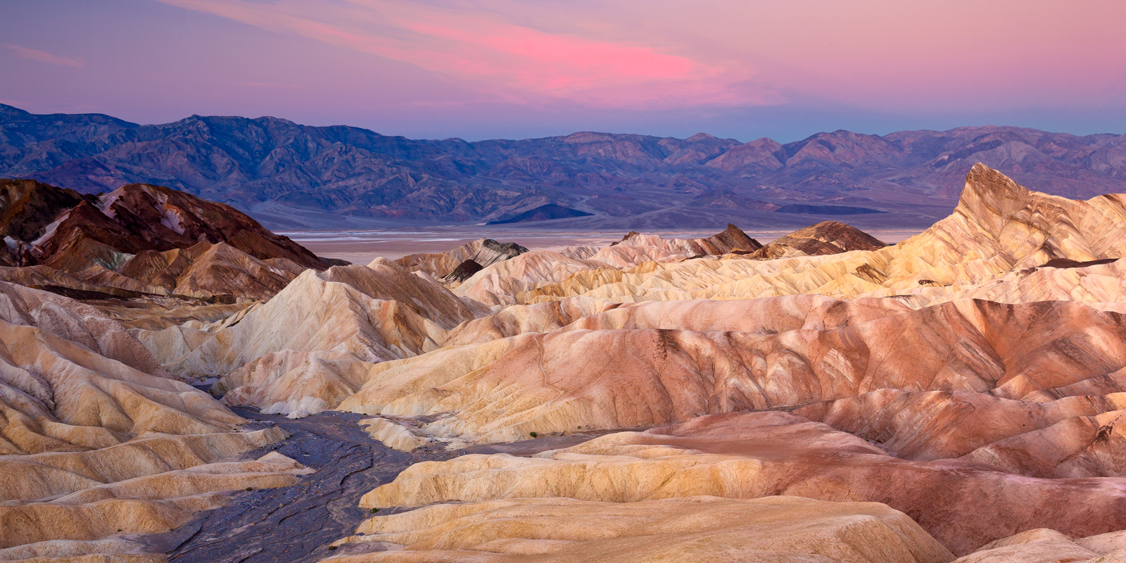 A Limited Edition, Fine Art photograph of the colors in the hardened sand at Zabriskie Point at sunrise in Death Valley National...