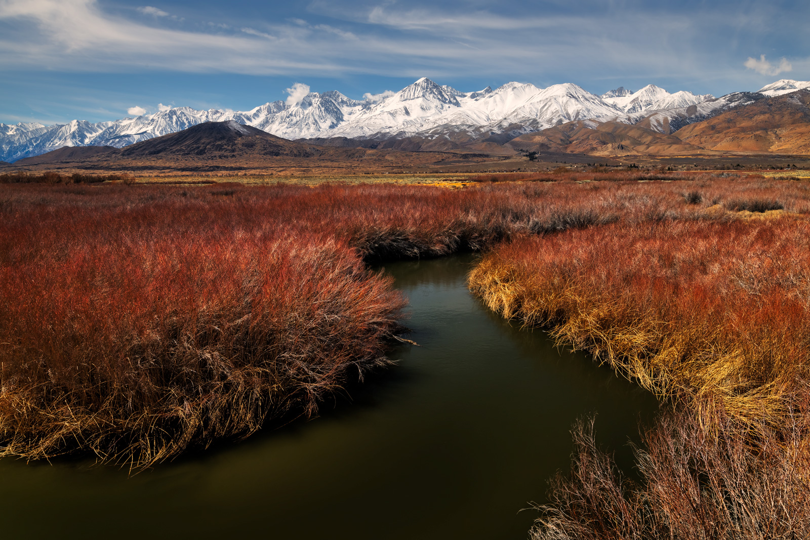 A Limited Edition photograph of the snow capped Eastern Sierra Mountains behind the Owens River in Bishop, California.  Available...