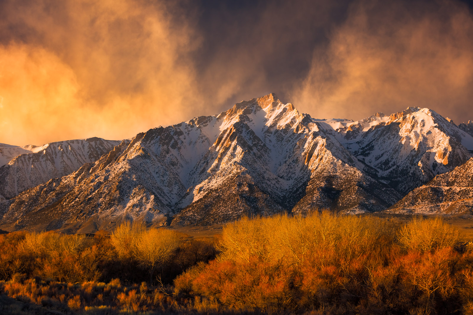 A Limited Edition, Fine Art photograph of an exceptional sunrise over the snow covered mountains and golden winter fields in...