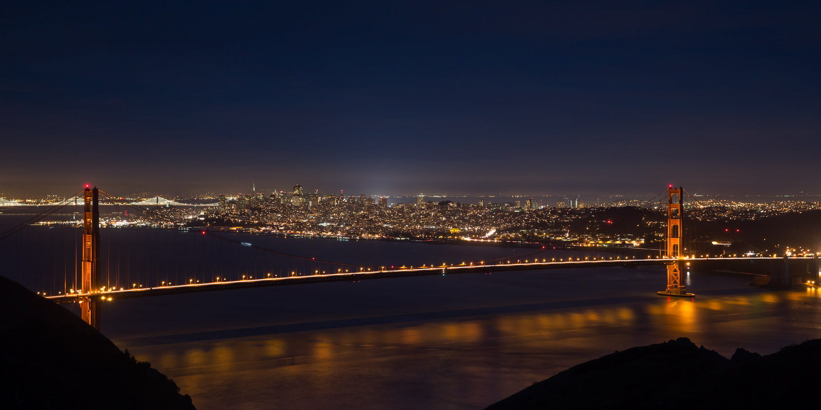 A Limited Edition, Fine Art photograph of the Golden Gate Bridge spanning the bay at night in San Francisco, California.  Available...