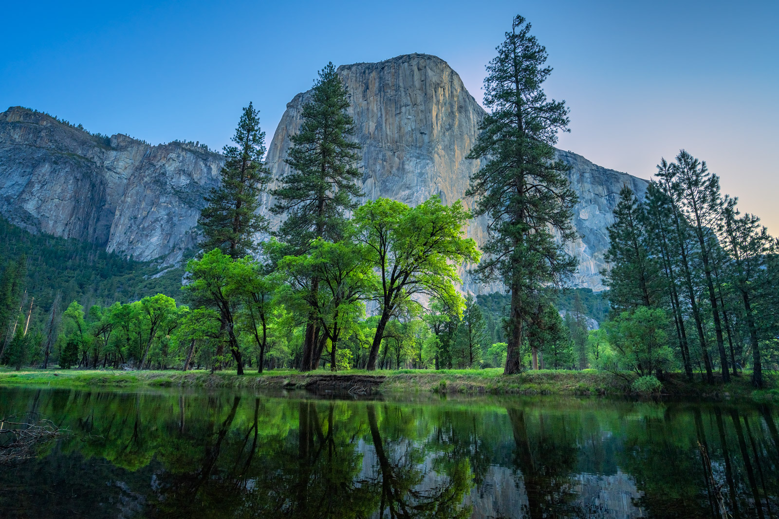 A Limited Edition, Fine Art photograph of El Capitan with trees reflecting in the Merced River at Yosemite National Park in California...