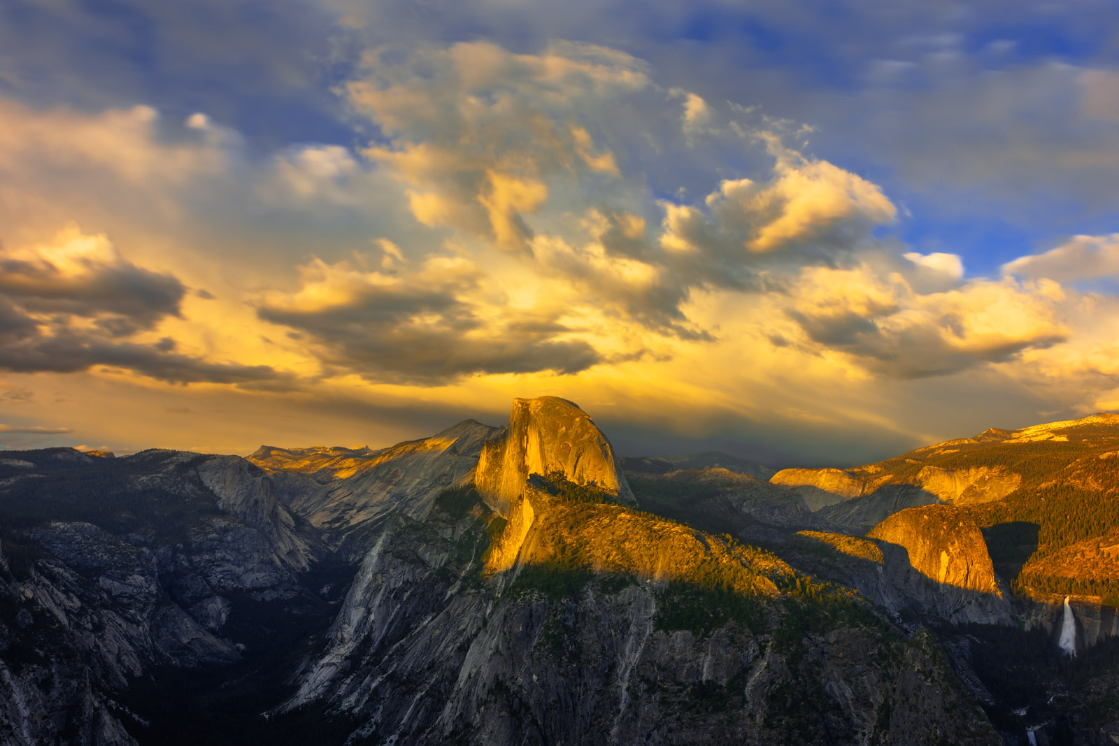 A Limited Edition, Fine Art photograph of Half Dome from Glacier Point during a glorious display at sunset at Yosemite National...