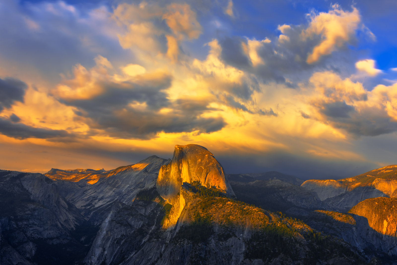 A Limited Edition, Fine Art photograph of Half Dome from Glacier Point with sunset clouds exploding at sunset at Yosemite National...