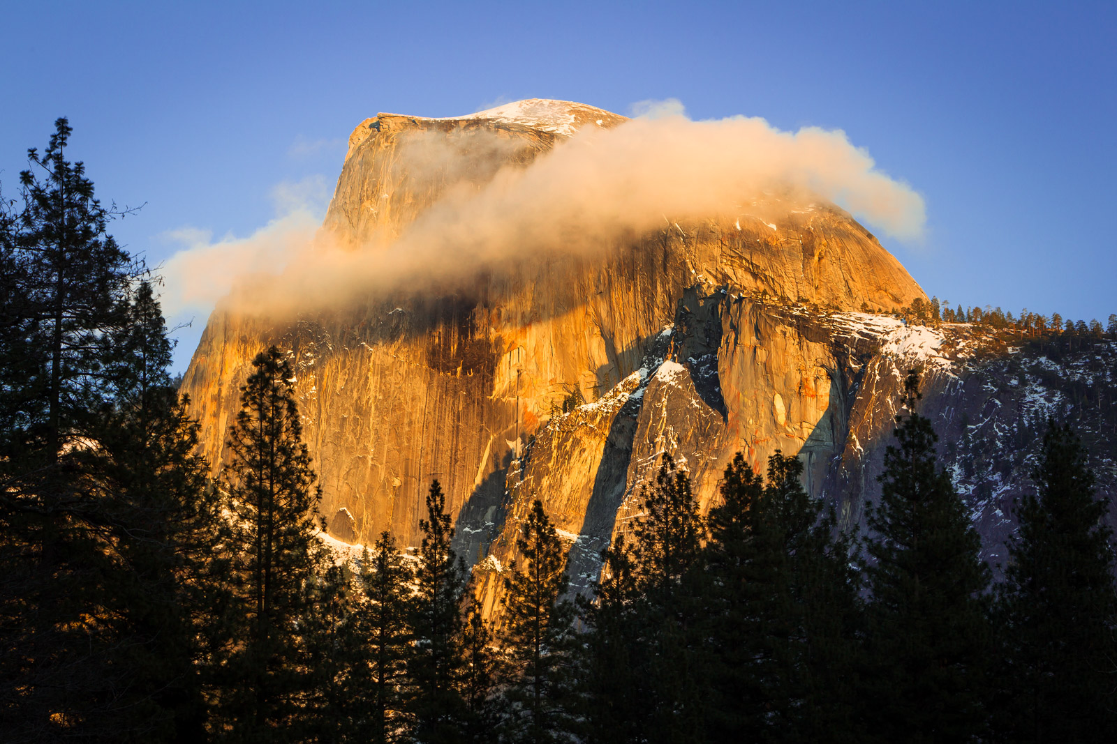 A Limited Edition, Fine Art photograph of a rare cloud ring around Half Dome at Yosemite National Park in California.  Available...