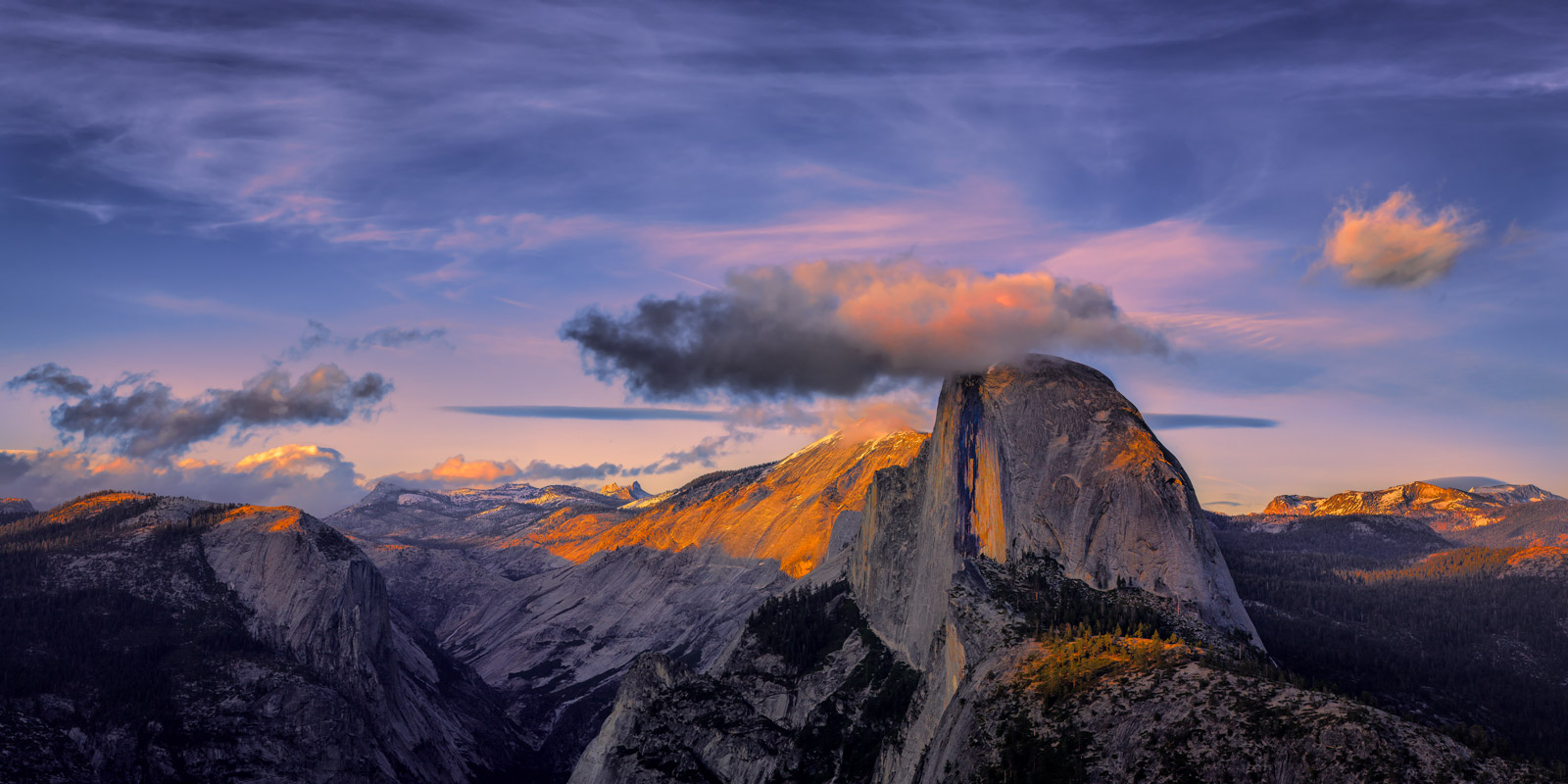 A Limited Edition, Fine Art photograph of a colorful dusk sunset over Half Dome from Glacier Point at Yosemite National Park...