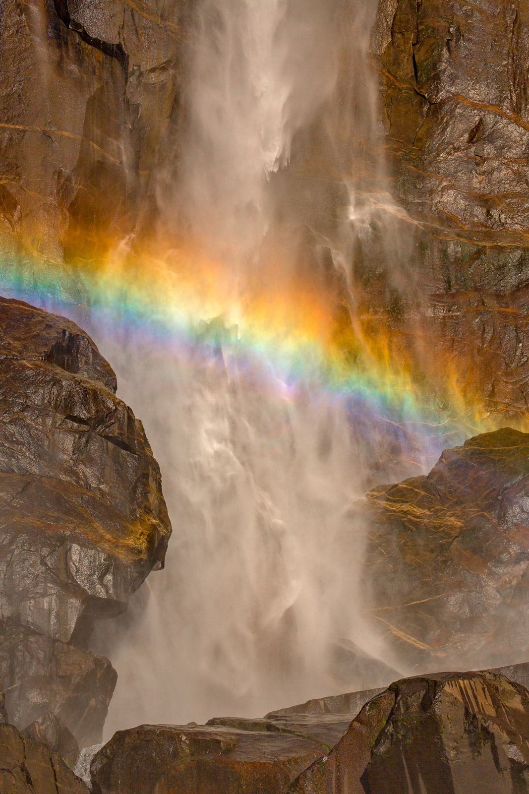 A Limited Edition photograph of a rainbow formed in the spray at the base of Bridalveil Falls at Yosemite National Park in California...