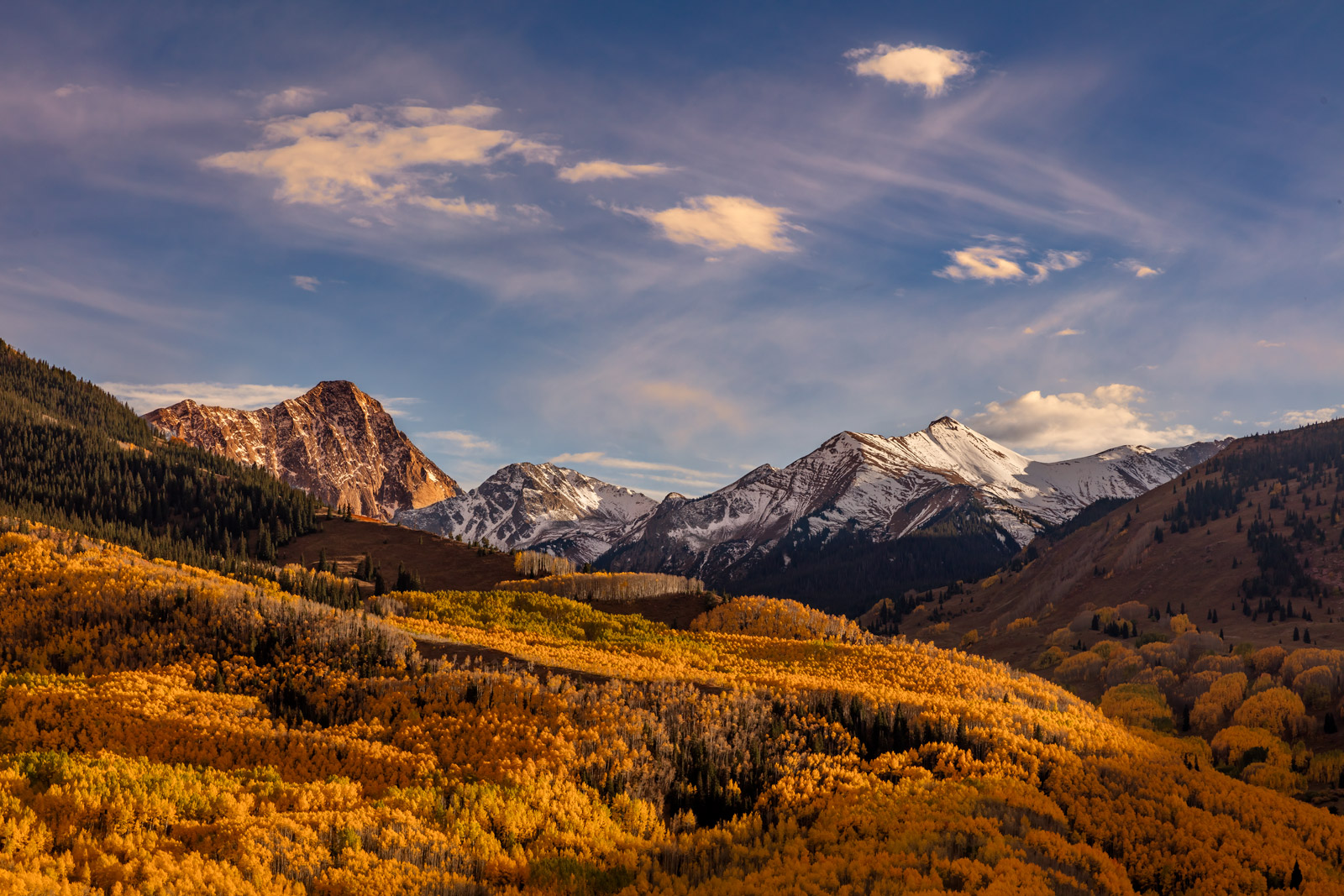 A Limited Edition, Fine Art photograph of Capitol Peak and the valley of brilliant fall colors below Capitol Peak and other mountains...