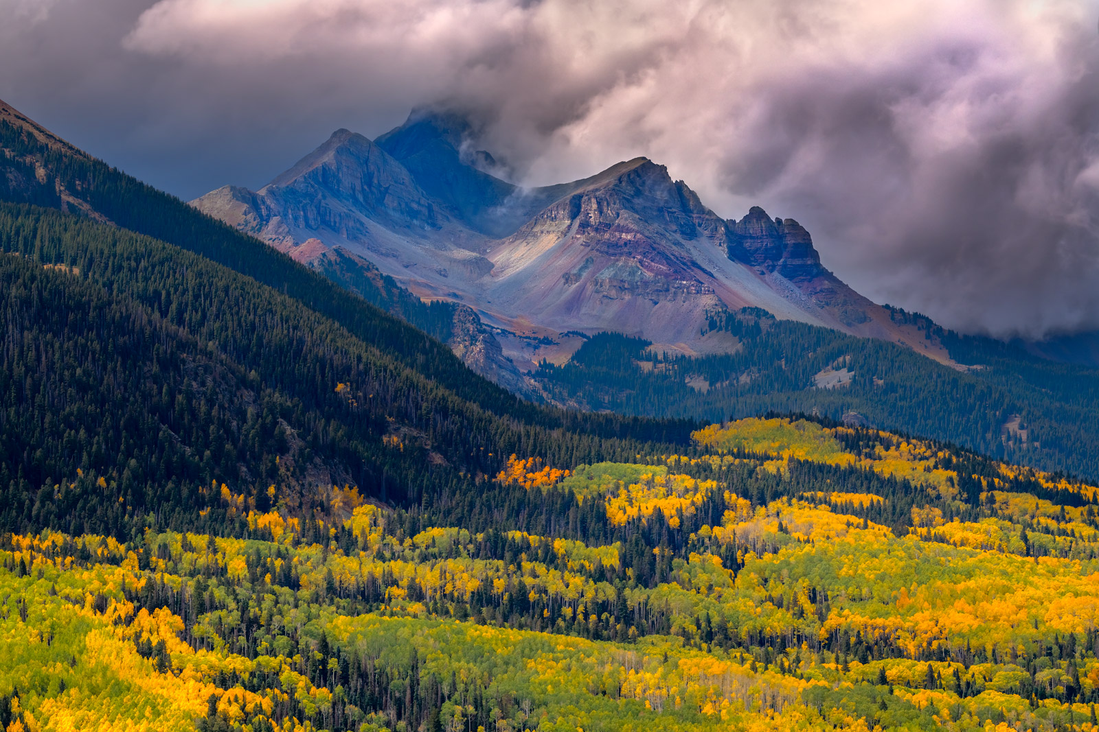 A Limited Edition, Fine Art photograph of a menacing storm approaching over Wilson Peak with a valley of fall colors in Southwest...