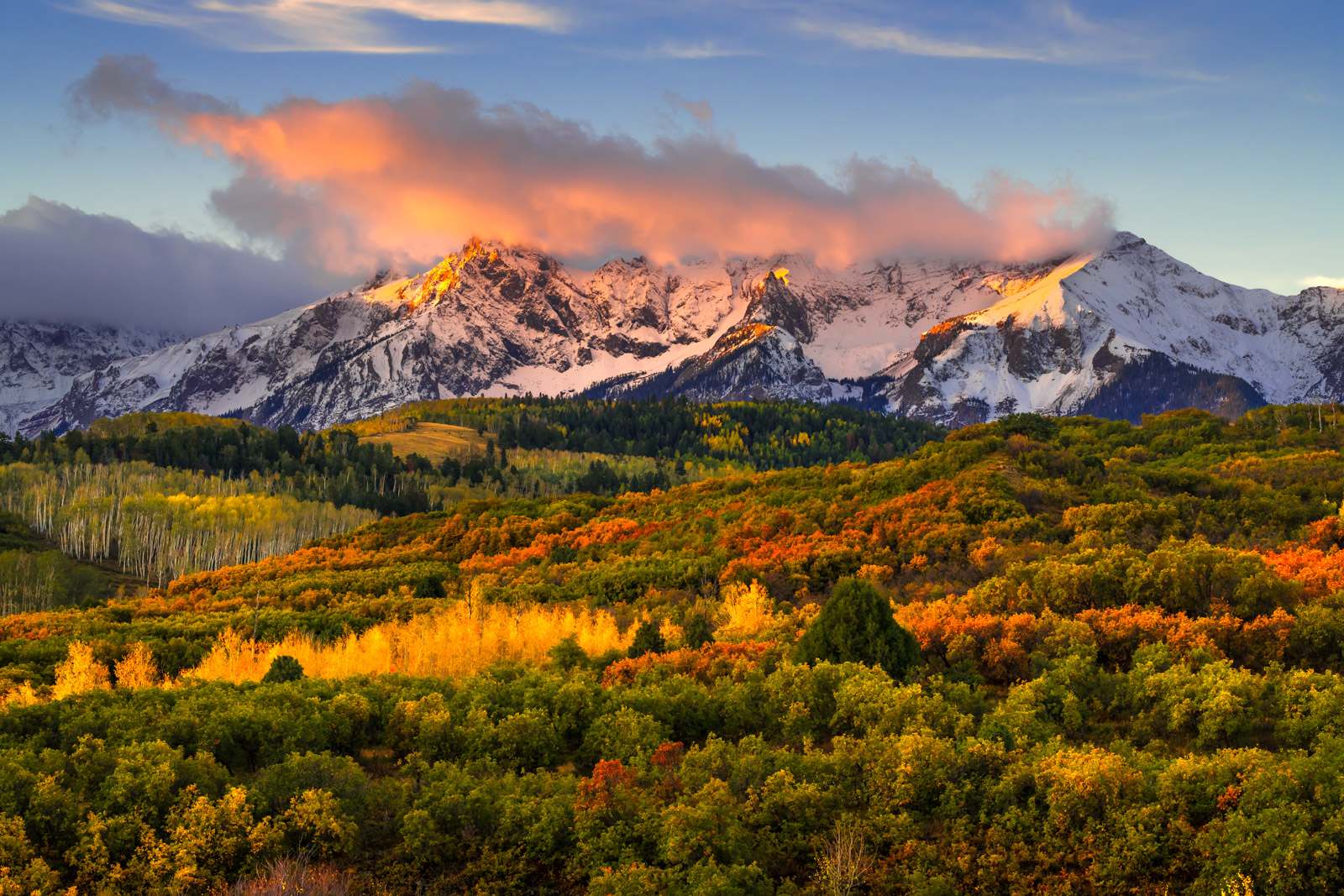 A Limited Edition, Fine Art photograph of snow capped mountains at sunrise above a valley of fall colors at the Dallas Divide...