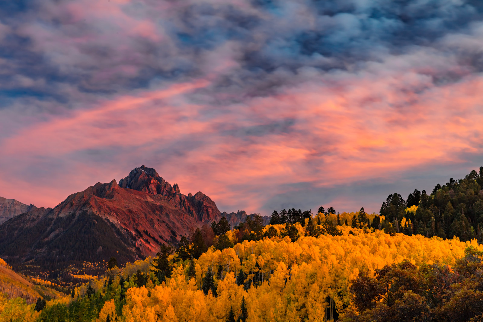 A Limited Edition, Fine Art photograph of a stunning sunset over Mount Sneffels and hills of fall colors in the San Juan Mountains...