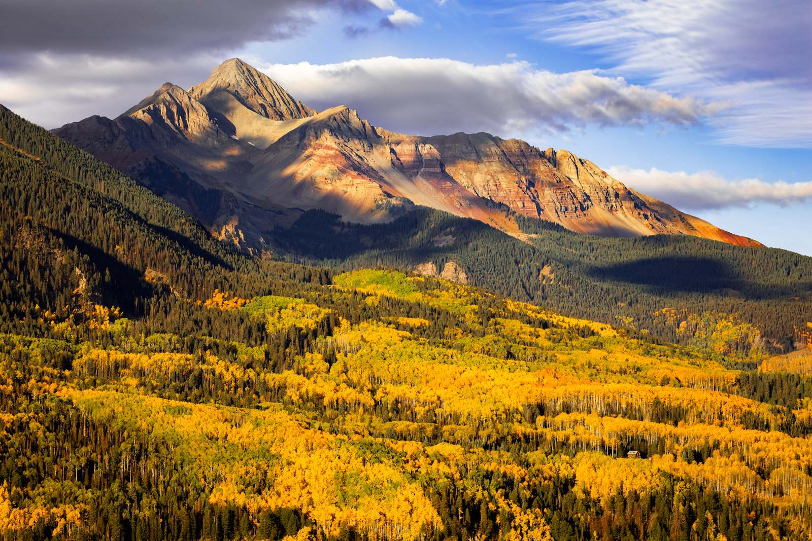 A Limited Edition, Fine Art photograph of Wilson Peak with brilliant fall colors in the valley beneath the mountain in the San...