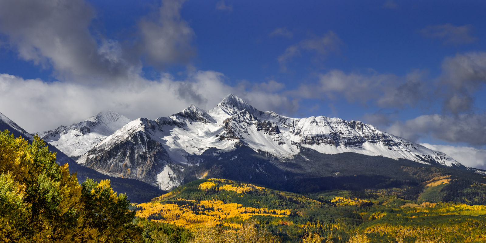 A Limited Edition, Fine Art photograph of a snow covered Wilson Peak with beautiful fall colors in the valley in front of the...