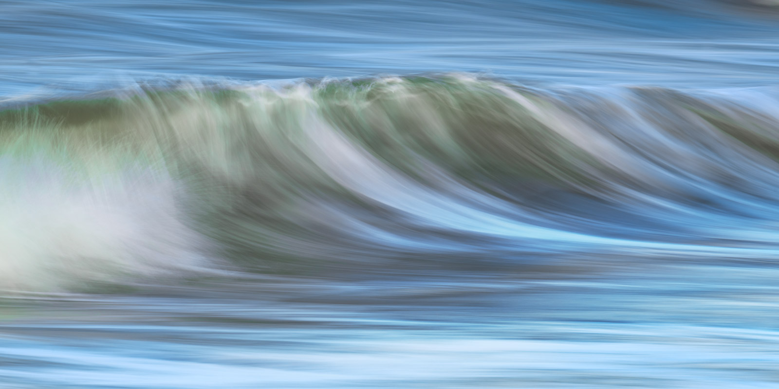 A Limited Edition, Fine Art abstract photograph capturing the blue and green colors in the water in the ocean off the coast of...