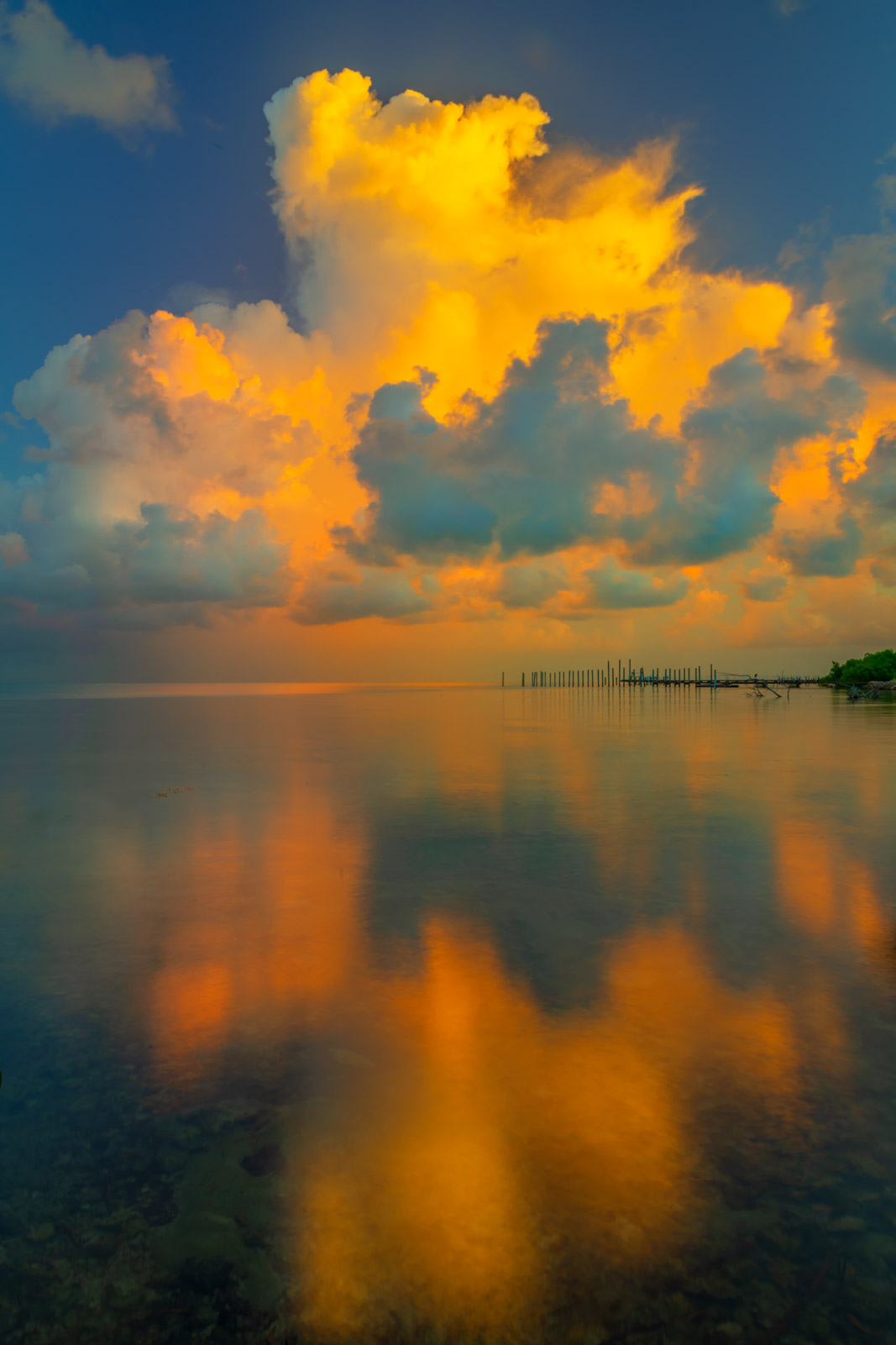 A Limited Edition, Fine Art photograph of sunrise storm clouds reflecting in calm water in Florida Bay in the Florida Keys. Available...