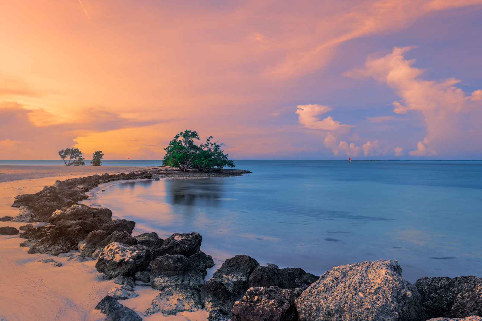 A Limited Edition, Fine Art photograph of aqua colored water in a cove at Sombrero Beach in the Florida Keys, Florida. Available...