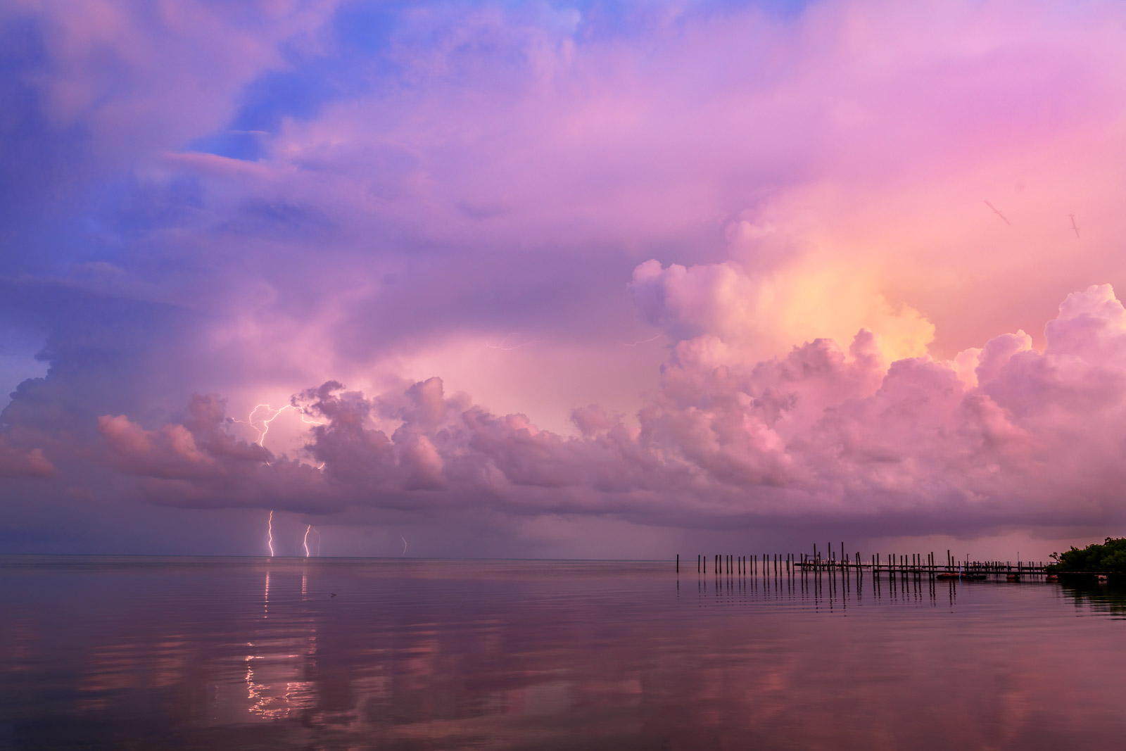 A Limited Edition, Fine Art photograph of a lightning strike at dawn in Florida Bay in the Florida Keys. Available as a Fine...