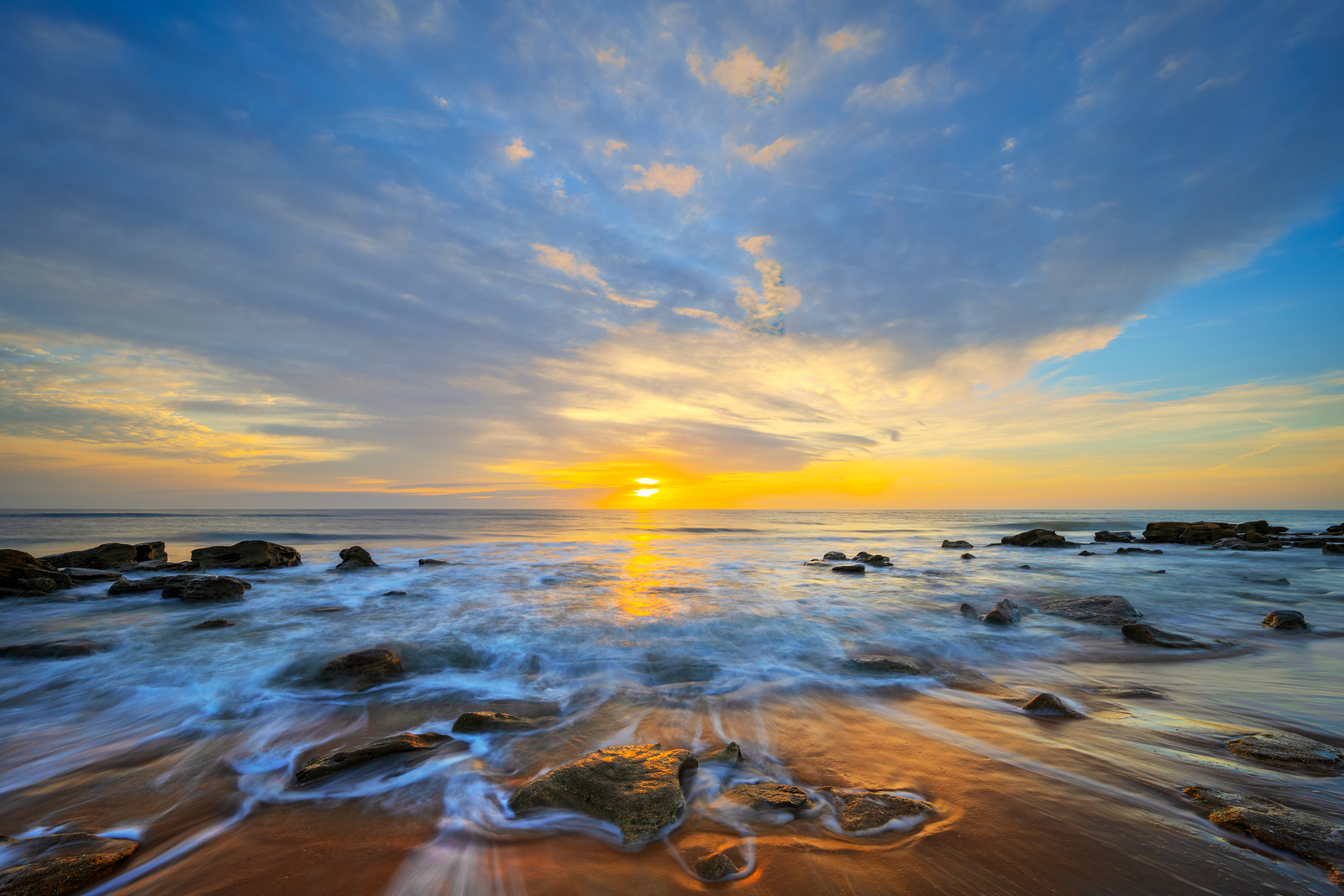 A Limited Edition, Fine Art photograph of sunrise over the Coquina Rocks on the beach at Washington Oaks State Park on the Atlantic...