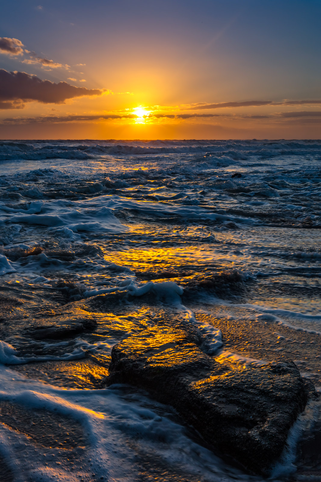 A Limited Edition, Fine Art photograph of dramatic scene of sunrise over the rocky coast  at Washington Oaks State Park in Florida...