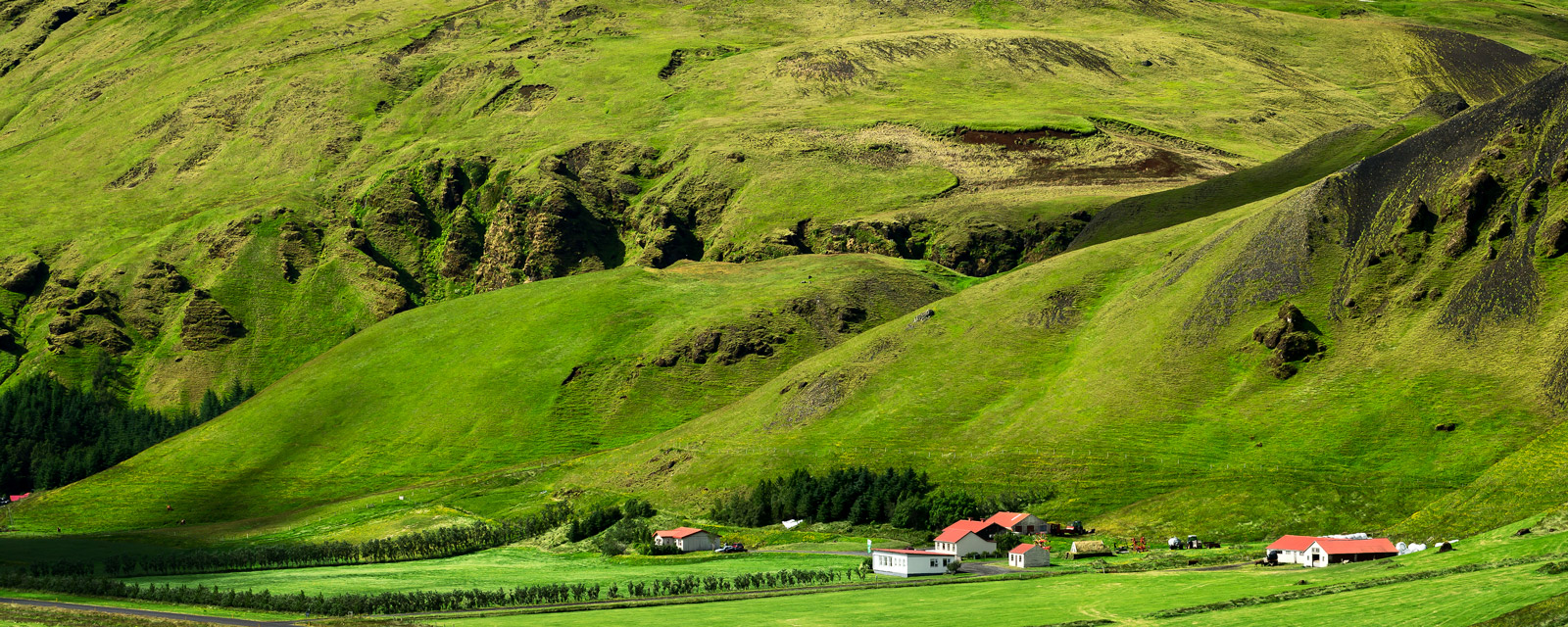 A Limited Edition, Fine Art photograph of an wonderful scene of a farm in front of rolling green hills in the summer in Vik...