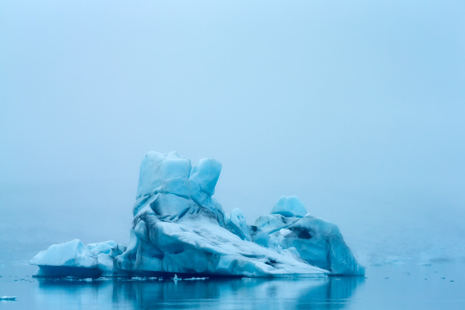 A Limited Edition, Fine Art photograph of an intriguing  ship shaped blue iceberg in the fog in the ice lagoon at Jokulsarlon...