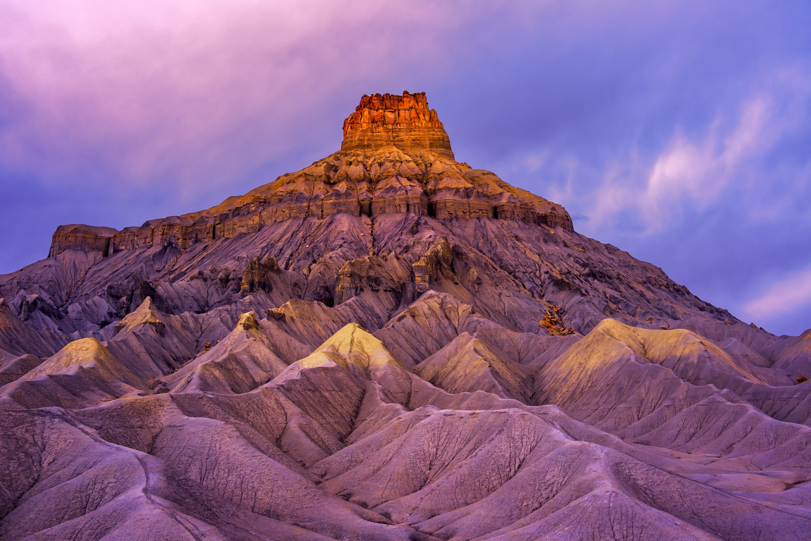 A Limited Edition, Fine Art photograph of sunrise light on Factory Butte in a remote desert in the Desert Southwest in Utah....