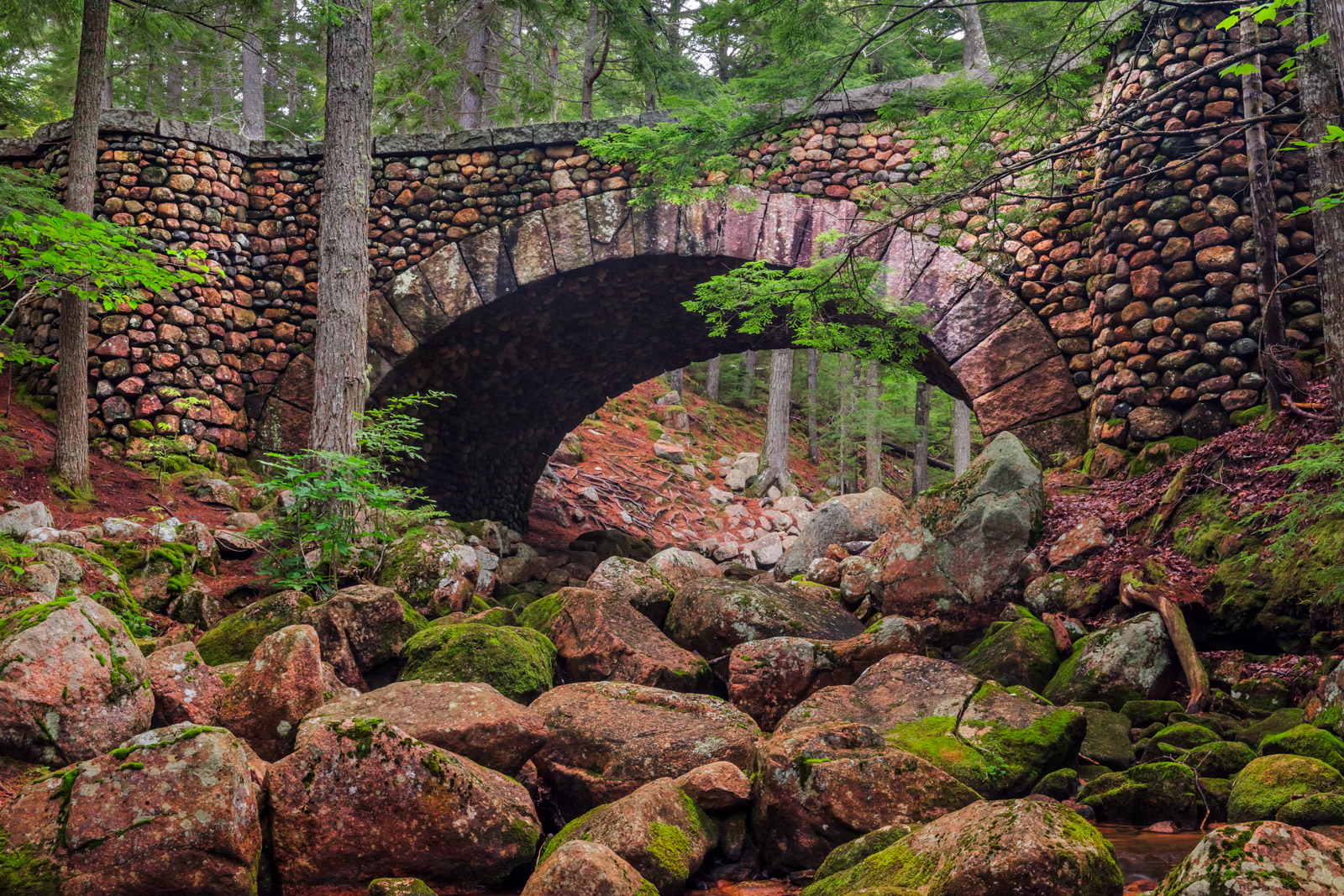 A Limited Edition, Fine Art  photograph of the charming Cobblestone Bridge spanning a river of boulders in Acadia National Park...
