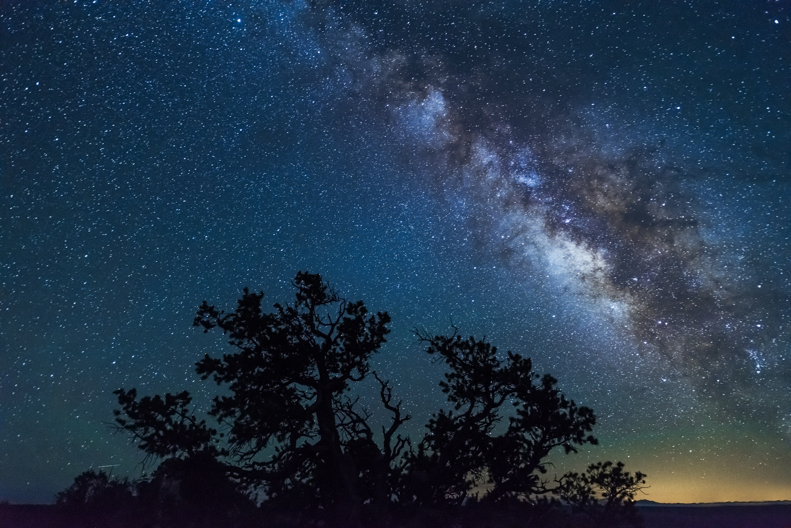 A Limited Edition, Fine Art photograph of the stars of the Milky Way over trees during a wonderous night at the Grand Canyon...