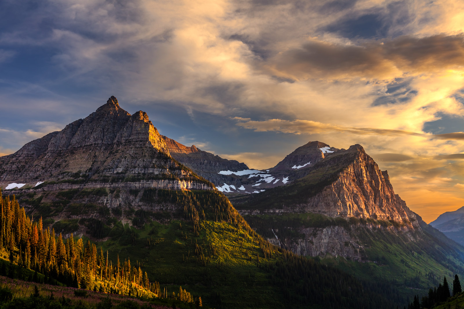 A Limited Edition, Fine Art photograph of a beautiful sunset over the majestic mountains of Glacier National Park in Montana....