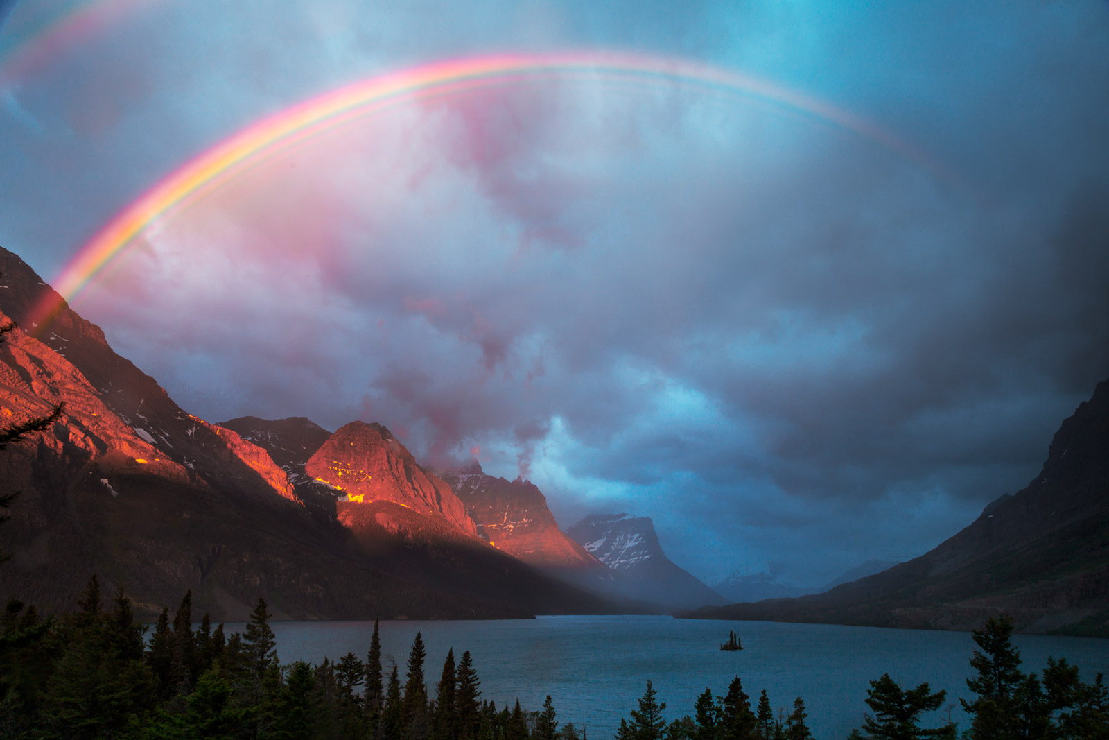 A Limited Edition, Fine Art photograph of Wild Goose Island with the many colors of the rainbow over it in Glacier National Park...