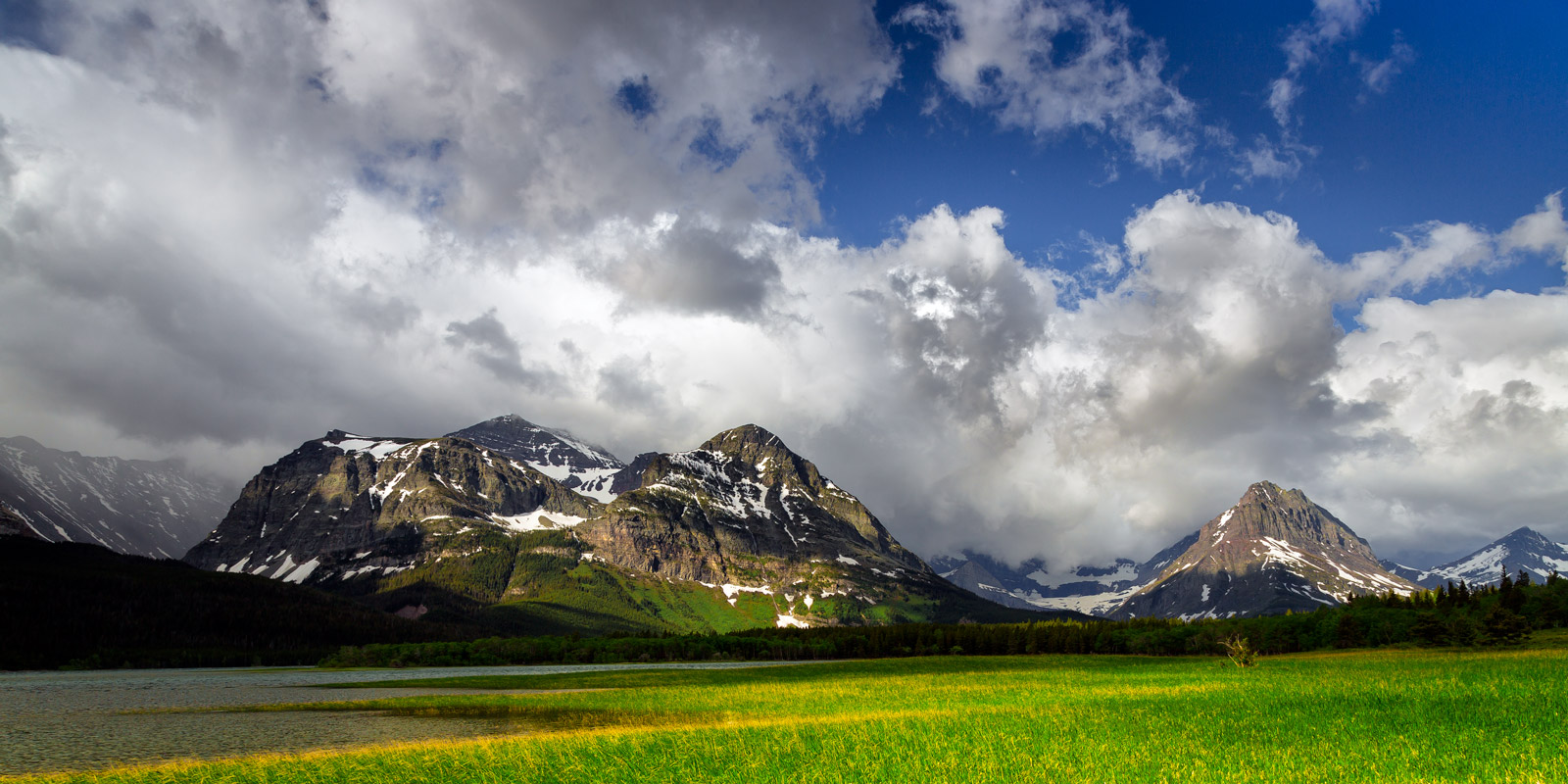 A Limited Edition, Fine Art photograph of storm clouds building up big over the mountains at Lake Sherburne in Glacier National...