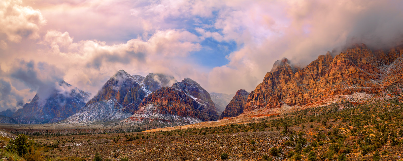 A Limited Edition, Fine Art photograph of Red Rock Canyon with a dusting of snow scattered on the mountains. Available as a Fine...