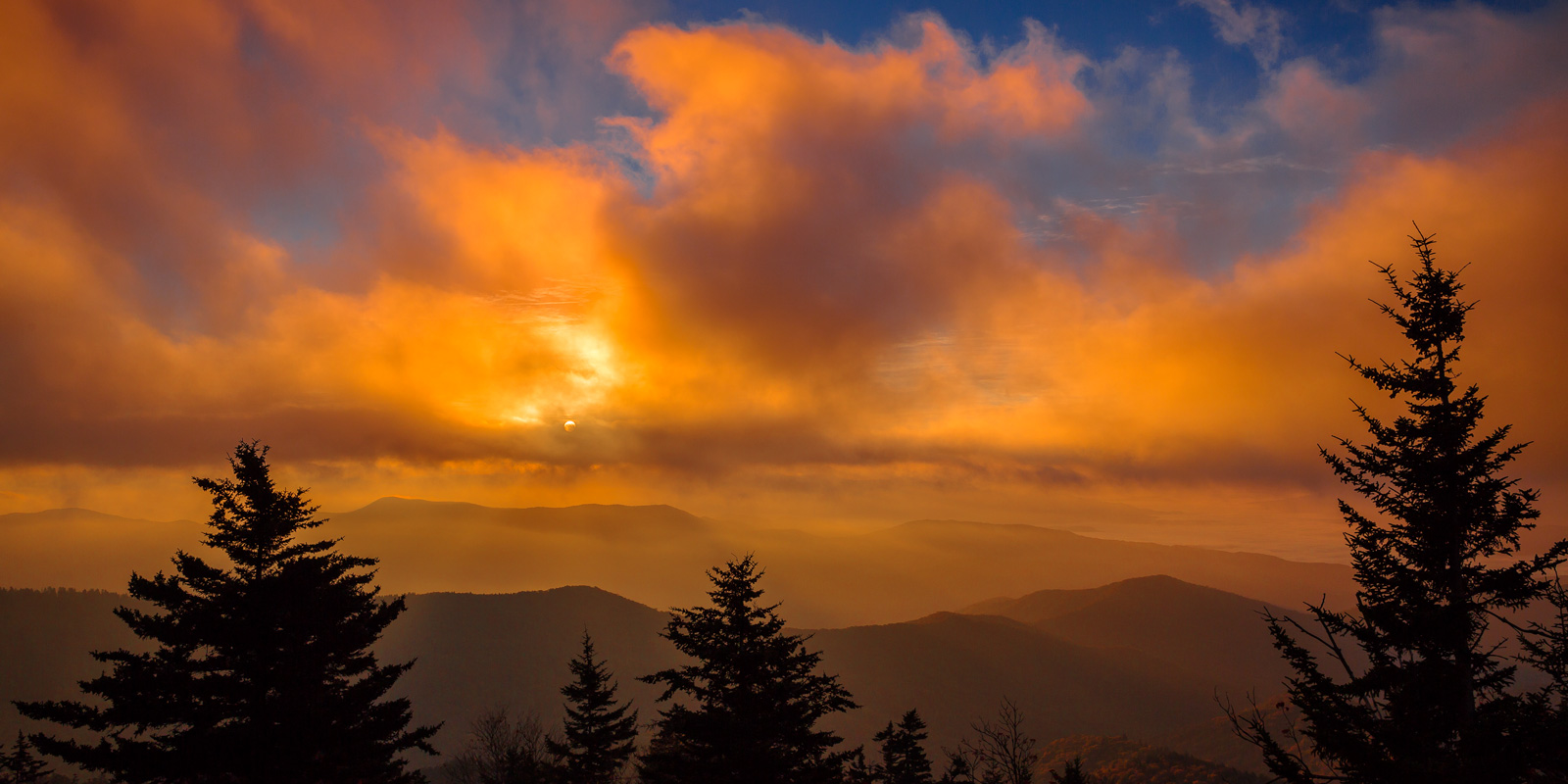 A Limited Edition, Fine Art photograph of the sun bursting through the clouds during beautiful sunrise at Clingman's Dome in...