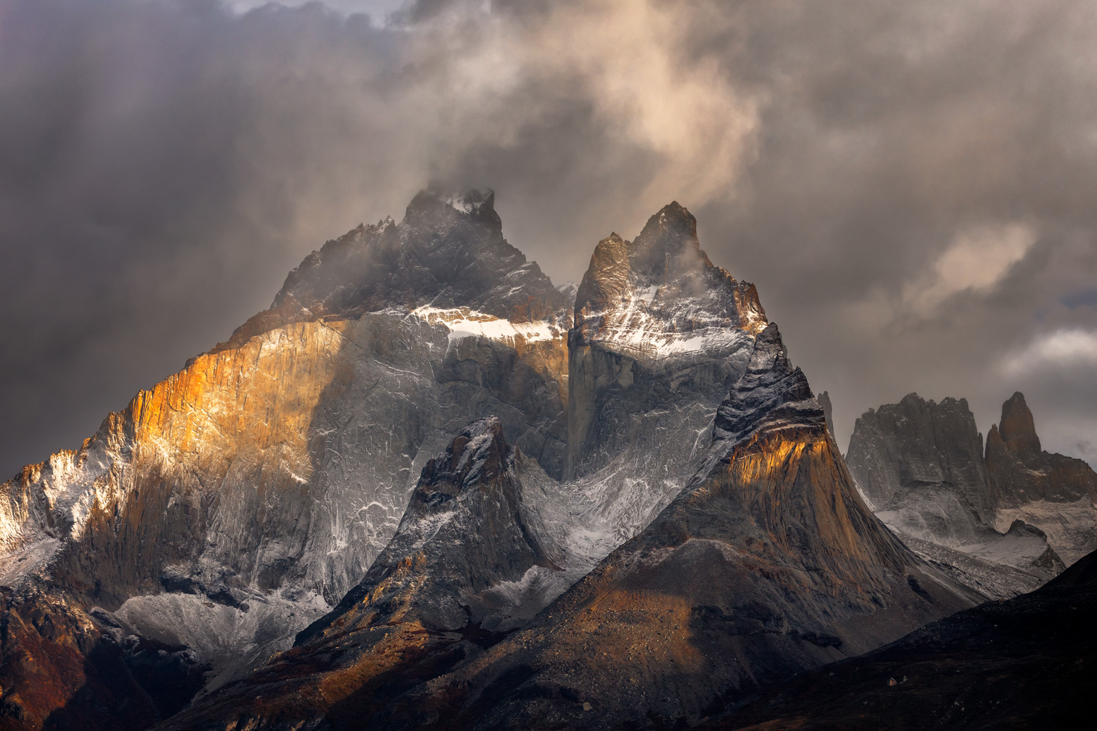A Limited Edition, Fine Art photograph of dramatic storm clouds surrounding the stormy peaks of the mountains of Torres del Paine...