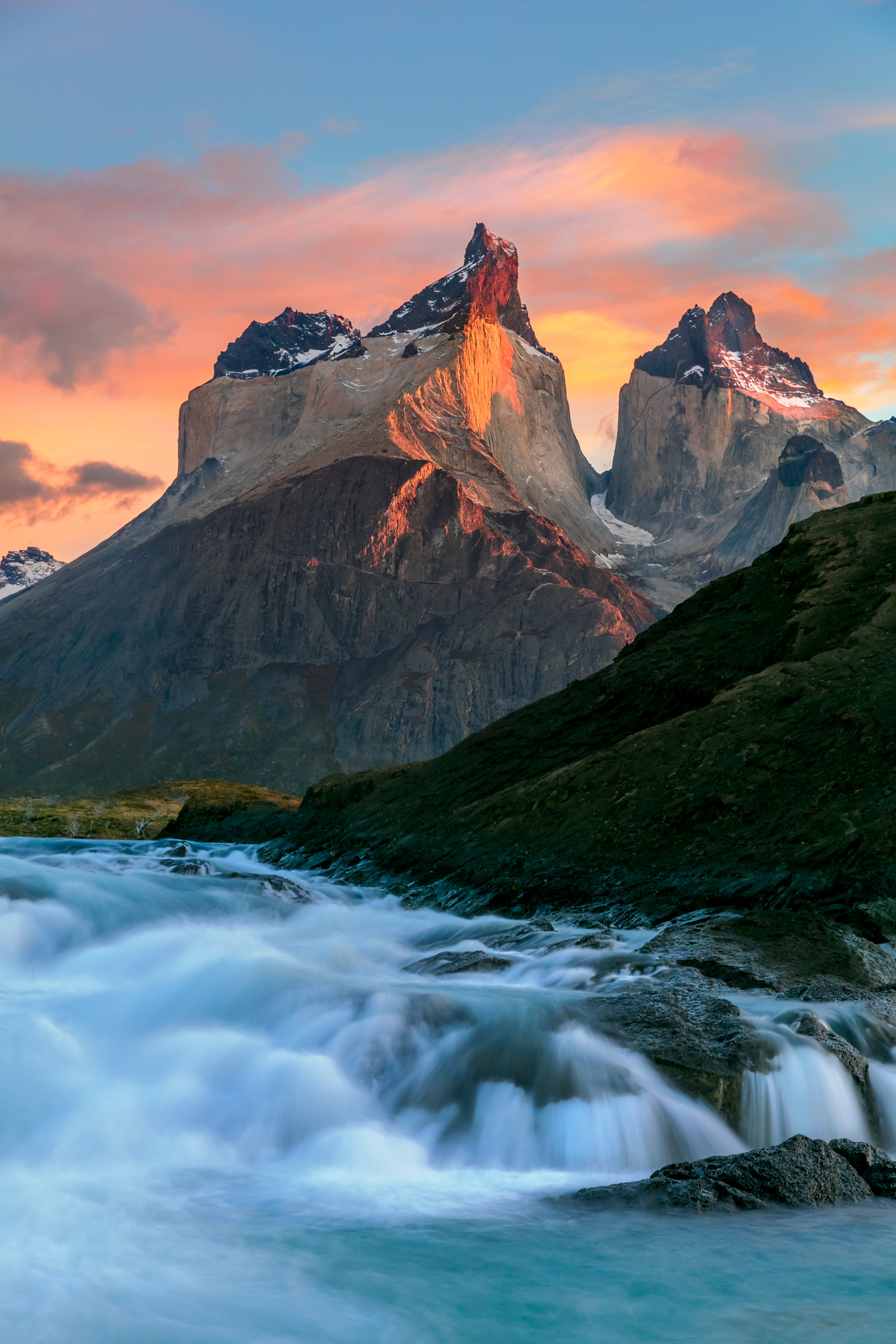 A Limited Edition, Fine Art photograph of the sunrise sky over Los Cuernos and the river cascades in Torres del Paine, Patagonia...