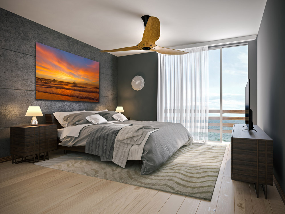 Preview of large beach sunrise photo hung above bed