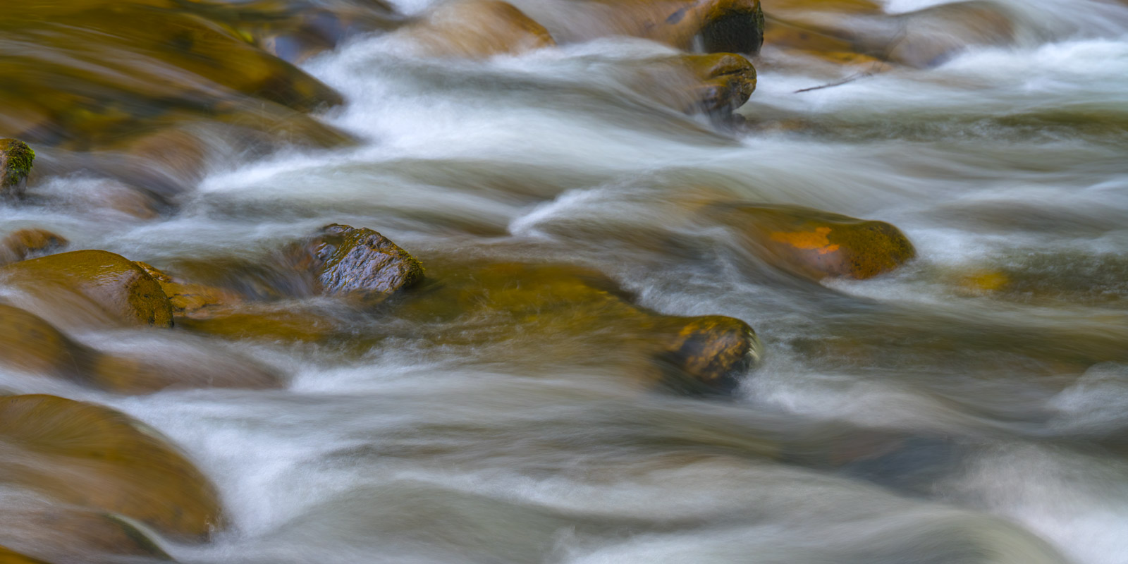 A Limited Edition, Fine Art abstract photograph capturing the flow of a Smoky Mountains river. Available as a Fine Art Print...