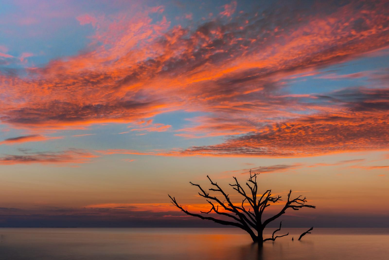 Carolina Coast Fine Art Photography A Limited Edition, Fine Art photograph of a brilliant red and orange sunrise over one of...