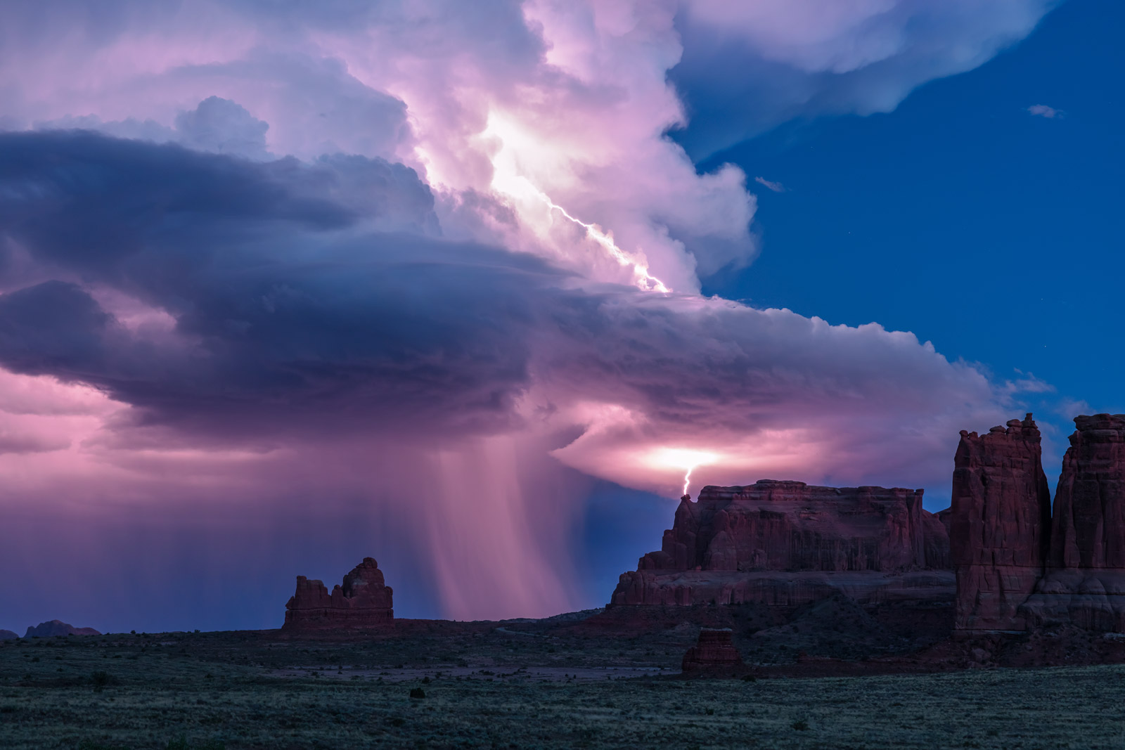 A Limited Edition, Fine Art photograph in Arches National Park of a dramatic lightning strike on the red rocks of the desert...