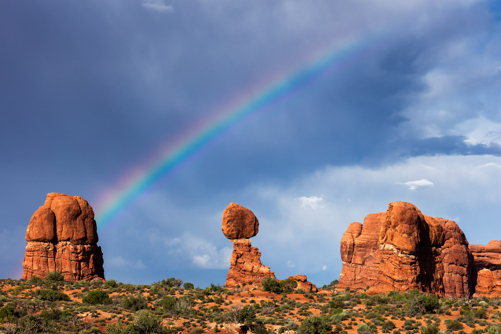 A Limited Edition Fine Art photograph of Balanced Rock in Arches National Park with a beautiful rainbow that appeared after a...